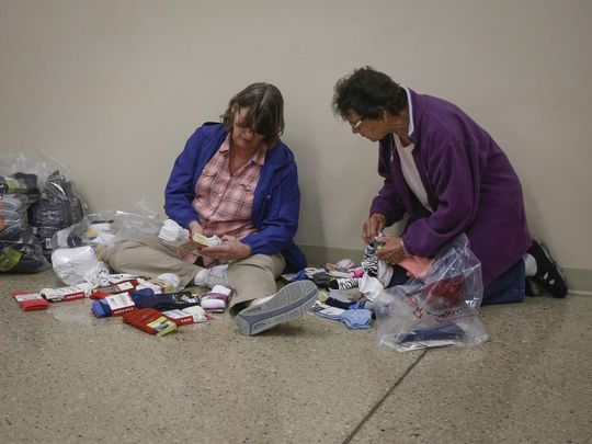 Rhonda Pecenka, left, of Boone, and Nancy Andresen of Des Moines sort their socks during the annual Fox River sock sale on Friday, Oct. 6, 2017, in Osage. (Photo: Bryon Houlgrave/The Register)