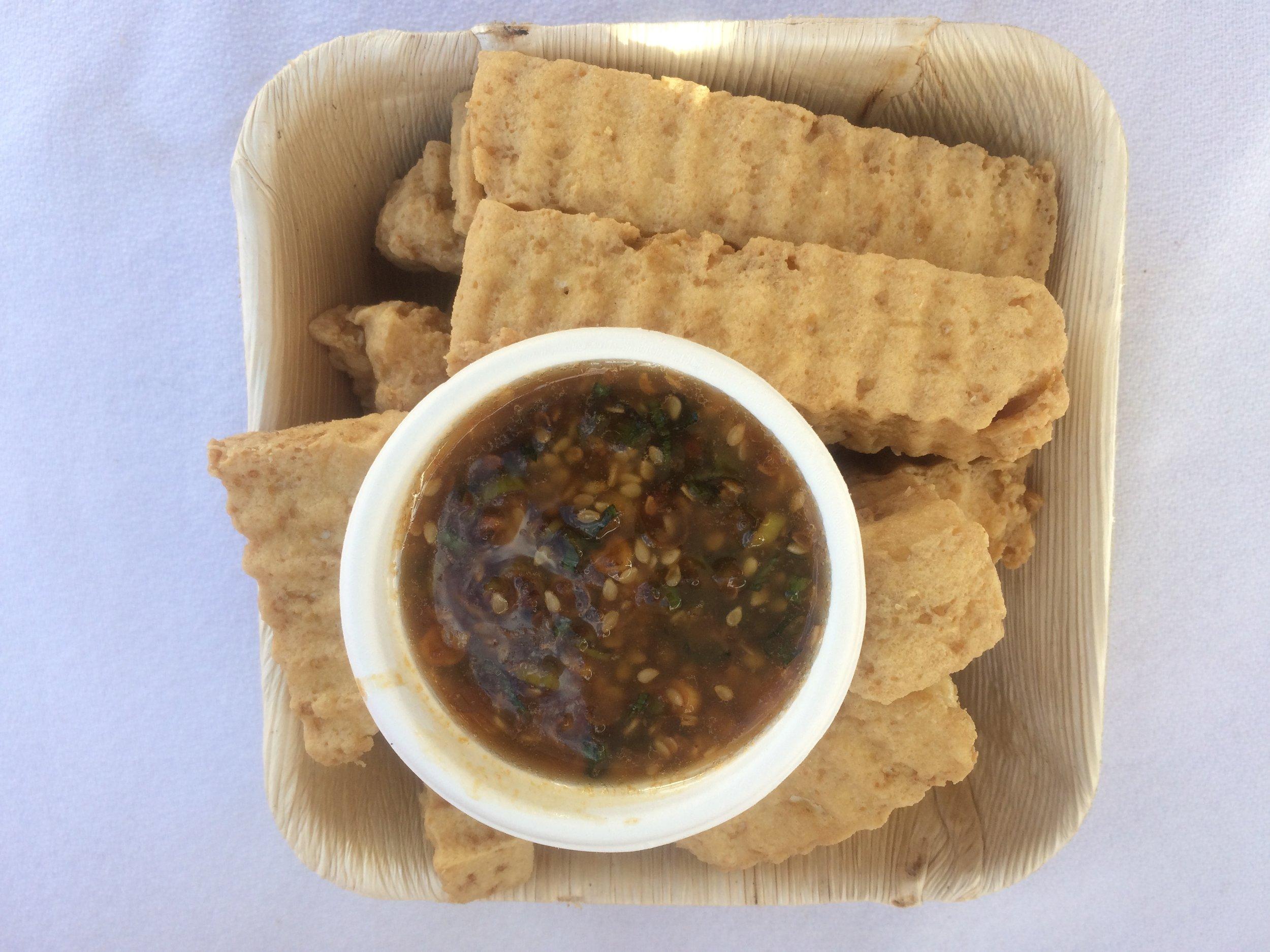 Crinkle-cut sea salt brined tofu fries that's our #1 seller at the fair.