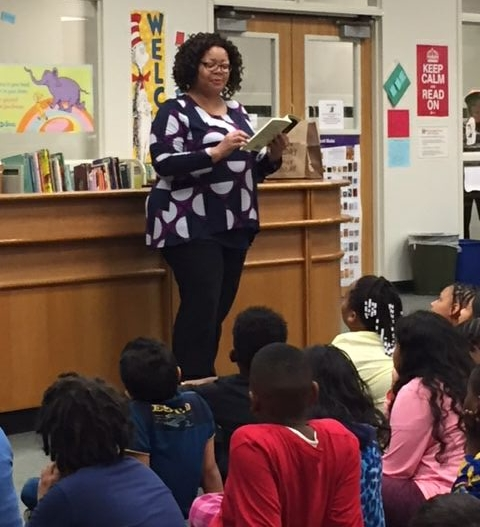 I love sharing my books and the writing process with kids. Here I am during an author visit, reading an excerpt of my book to fourth-graders.