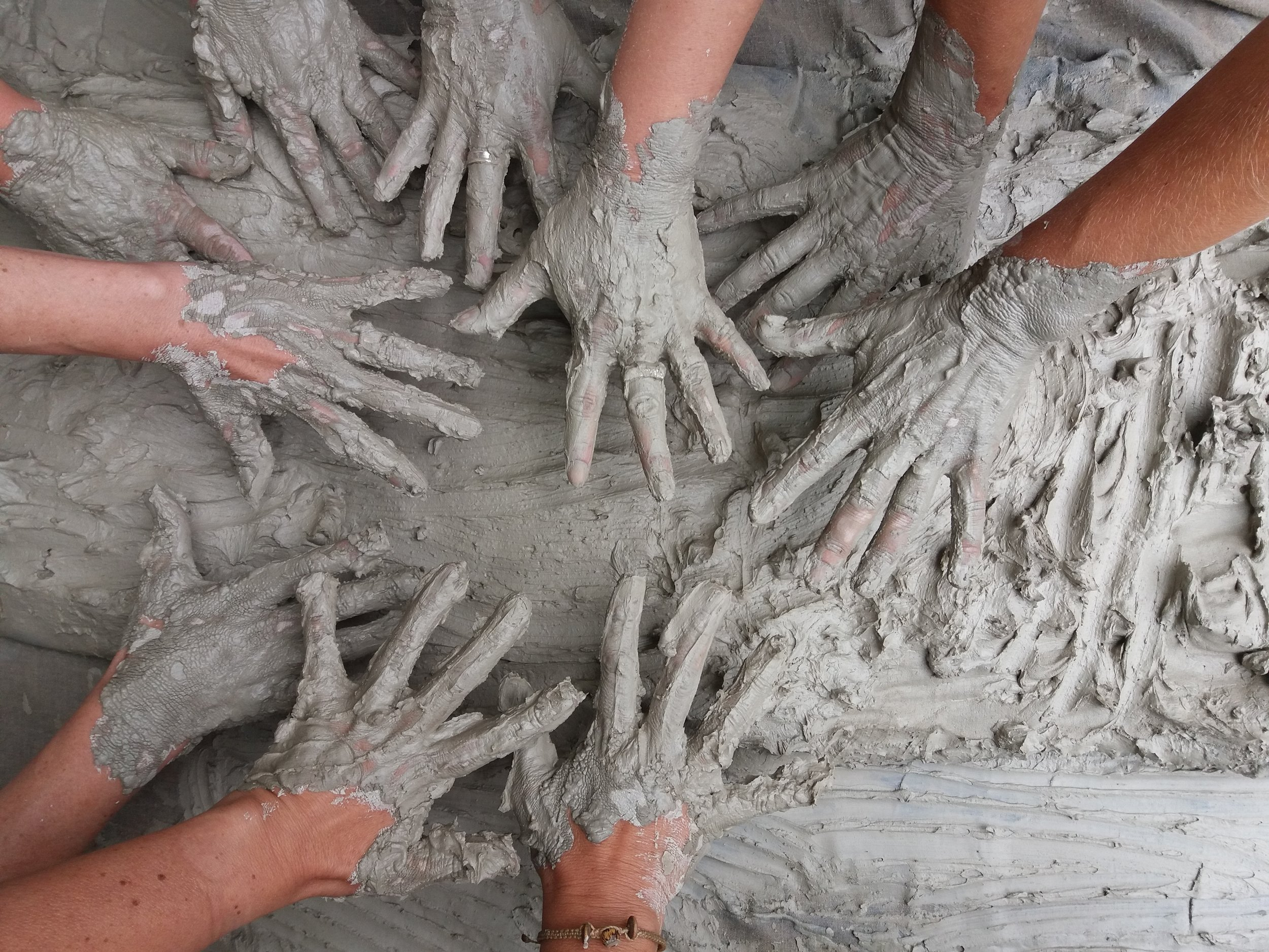 hands in clay.jpg