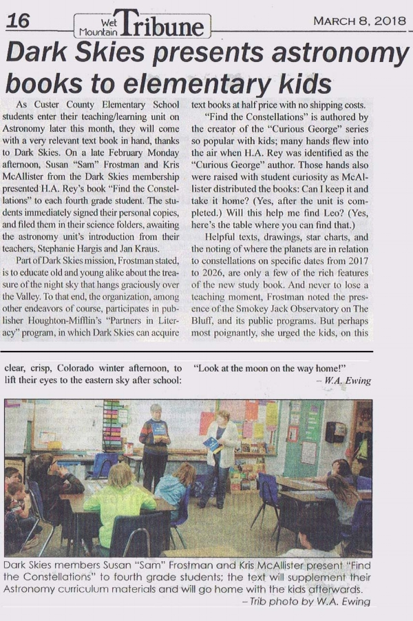 """Dark Skies members Susan """"Sam"""" Frostman and Kris McAllister present donated astronomy books to local elementary."""