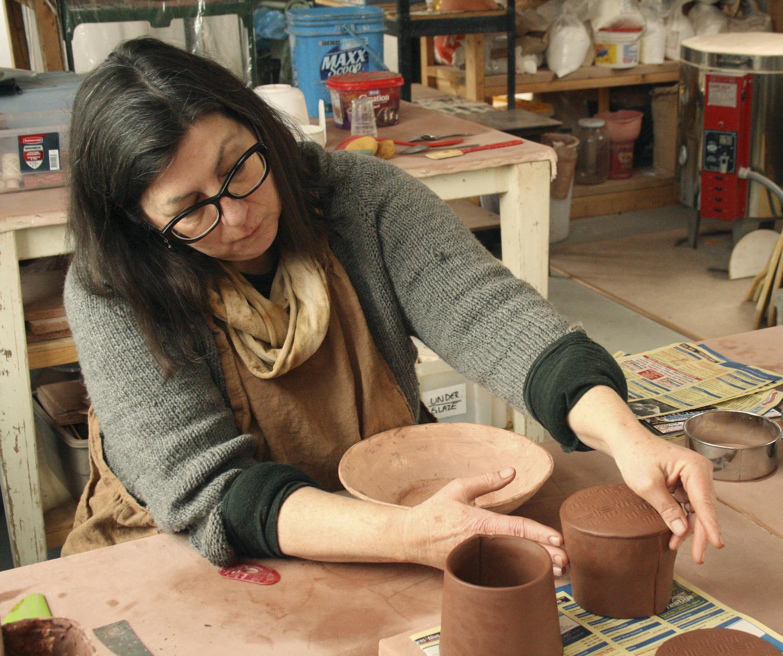 Working on mugs.