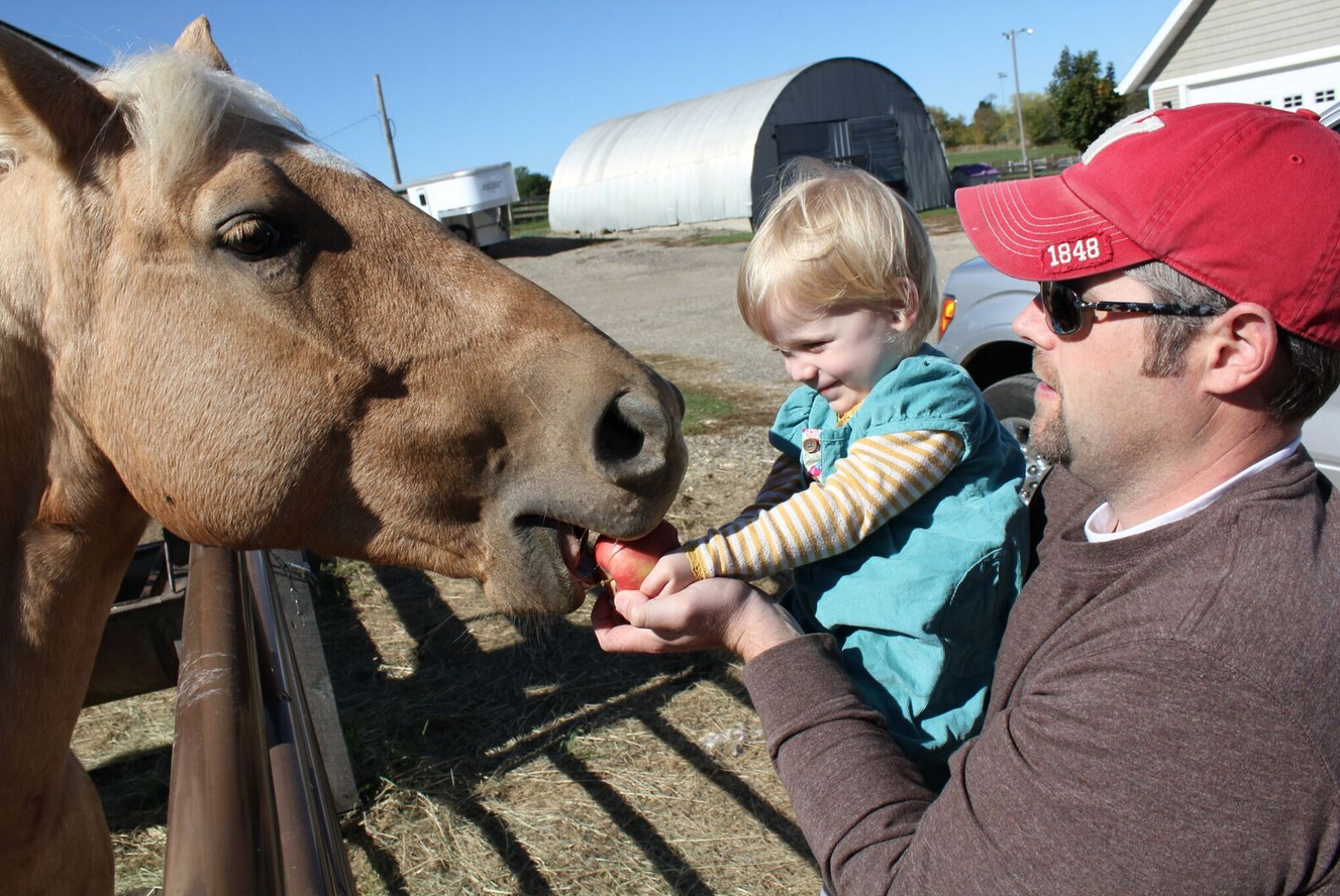 Honey the horse, Brent, and our daughter at age 2