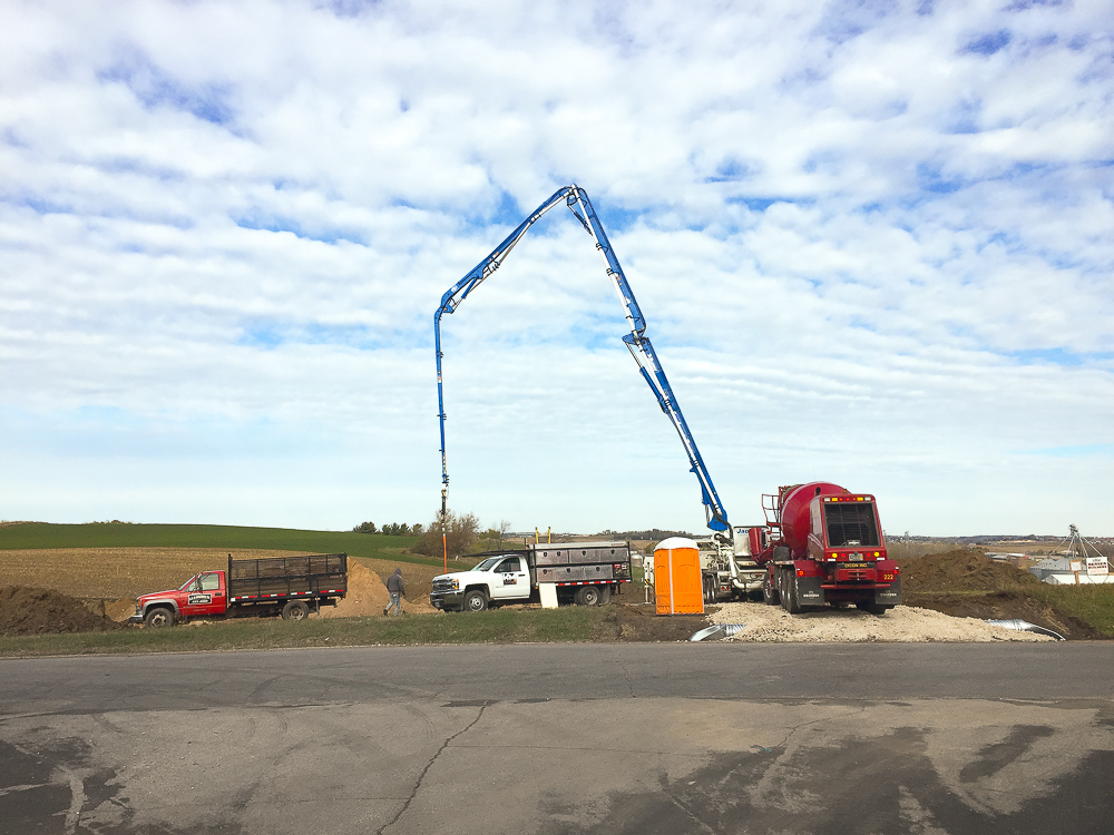 A pump truck is used to make the concrete foundation walls. Blue sky today!