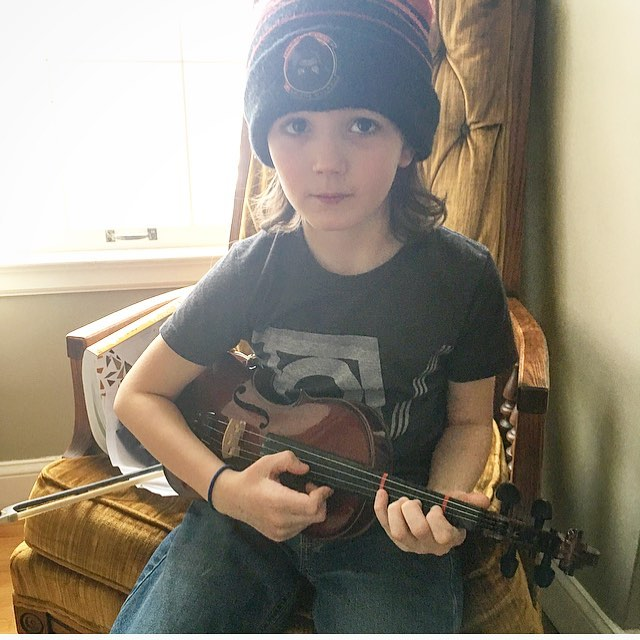 He's so cute. Also, he wears our TOV T-shirt so much I have to steal it away to wash it. 😍 @seniahevets #littleviolinist #violin #music #musically #tov
