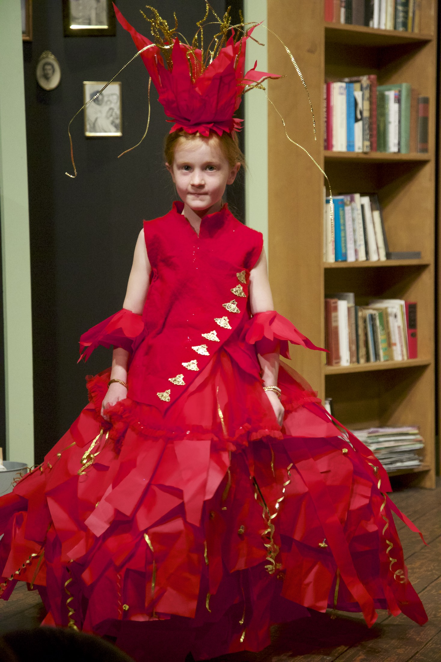 "Anora Kuzman, 6, wore and modeled her creation, ""Fire Goddess""  Photo Credit: Steve Mullensky for Peninsula Daily News"