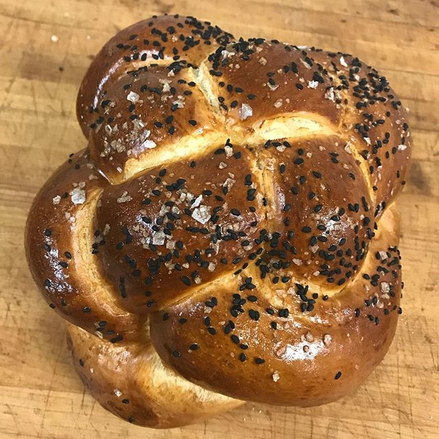 Our braided round #challah is the same weight as our standard six strand braid, just a different shape. As always it's made with #honey from local apiary #shipwreck honey and can be ordered plain or with black sesame and sea salt. Click the link in our profile and place an order before noon on Thursday for pick up between noon and two on Saturday at our commissary space in Wallingford. #RoshHashanah #sweetnewyear