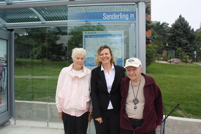 With Sanderling residents Nancy Halford and Ted Chrabaszcz in front of the new bus shelter at 20 Sanderling Place.