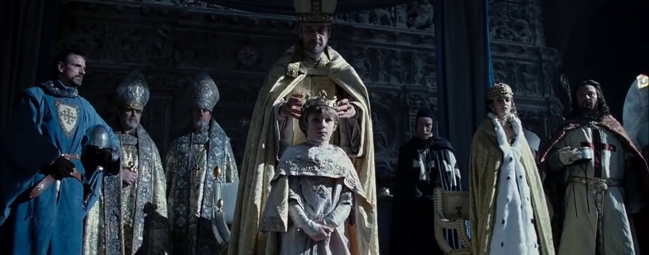 The coronation of King Baldwin V of Jerusalem in  Kingdom of Heaven . Tiberias (Jeremy Irons), Sibylla (Eva Green), and Guy of Lusignan (Marton Csokas) look on.