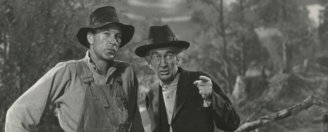 gary cooper and walter brennan as alvin york and rev. rosier pile in a Warner Brothers publicity still for  Sergeant York  (1941).
