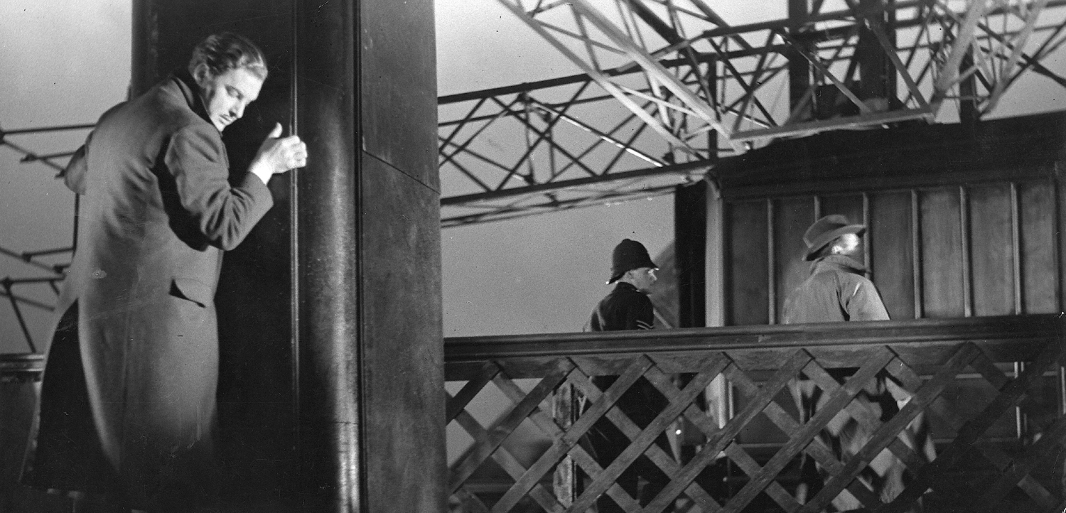Richard Hannay (Robert Donat) clings to the side of the Forth Bridge to escape detection in Alfred Hitchcock's  The 39 Steps