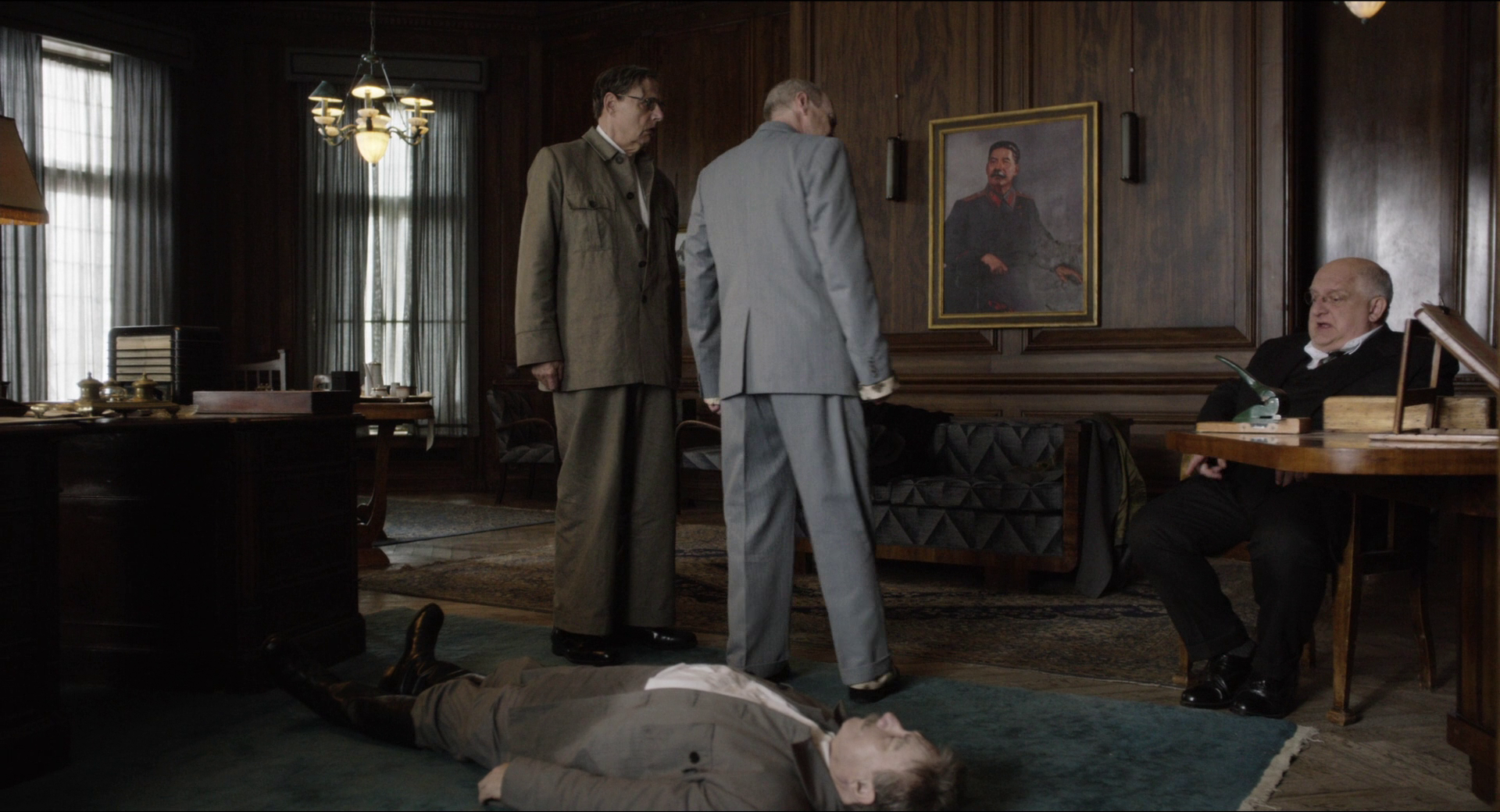 Adrian McLoughlin as Stalin, Jeffrey Tambor as Malenkov, Steve Buscemi as Khrushchev, and Simon Russell Beale as Beria in  The Death of Stalin