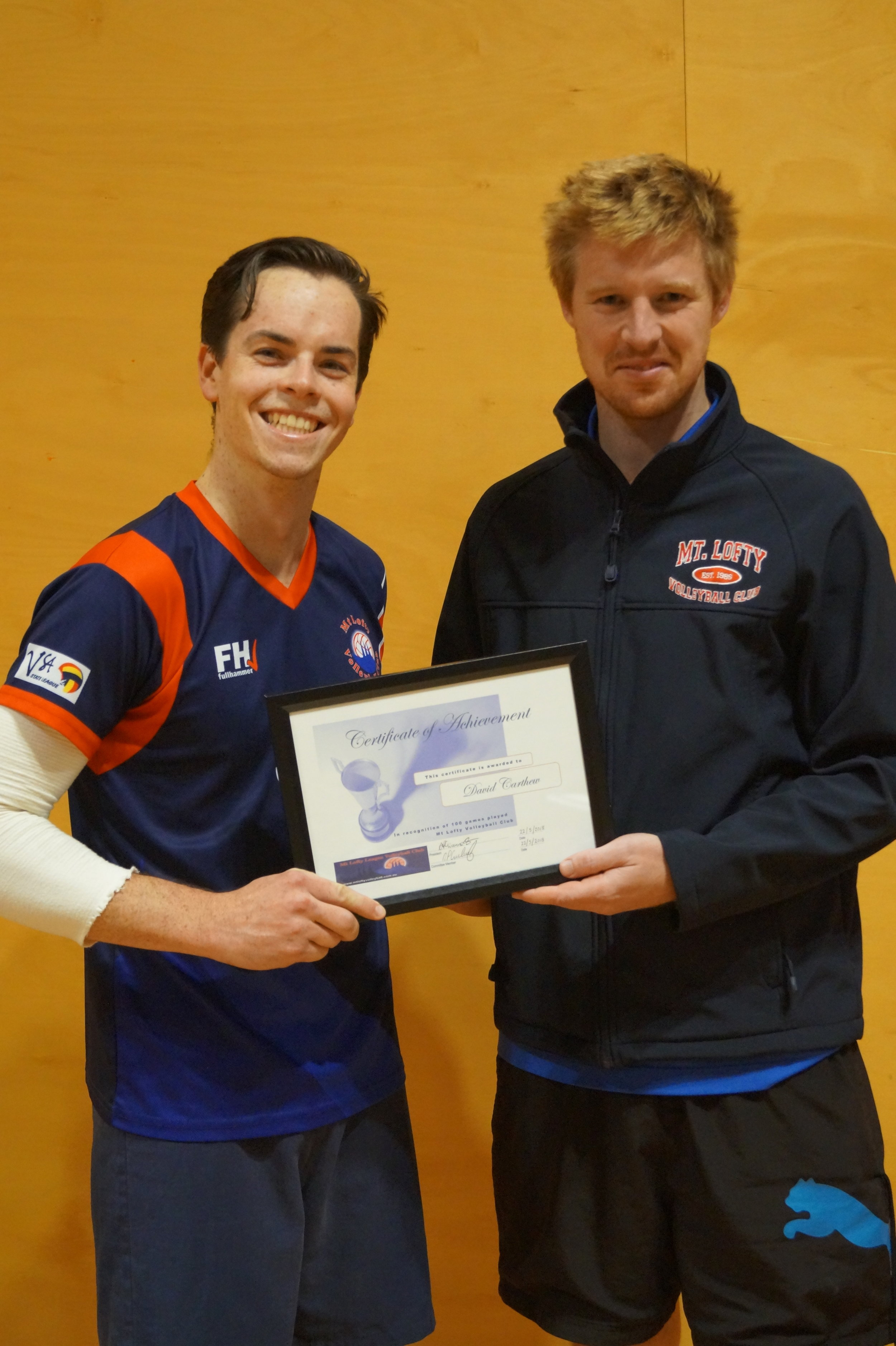 David gets his 100 game certificate from league reserve coach Aaron Kempe.