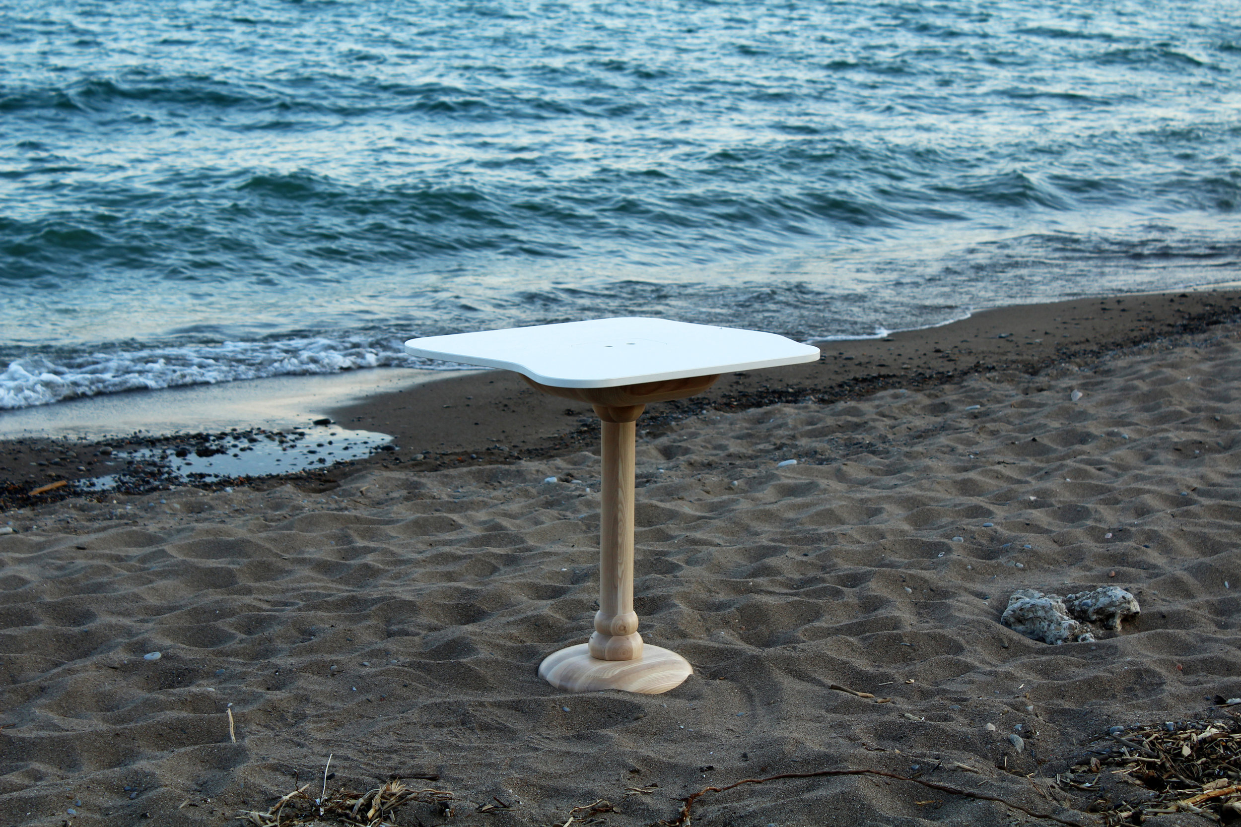 The Sea Table designed for Sara Restaurant, with a Caesarstone tabletop and solid ash pedestal