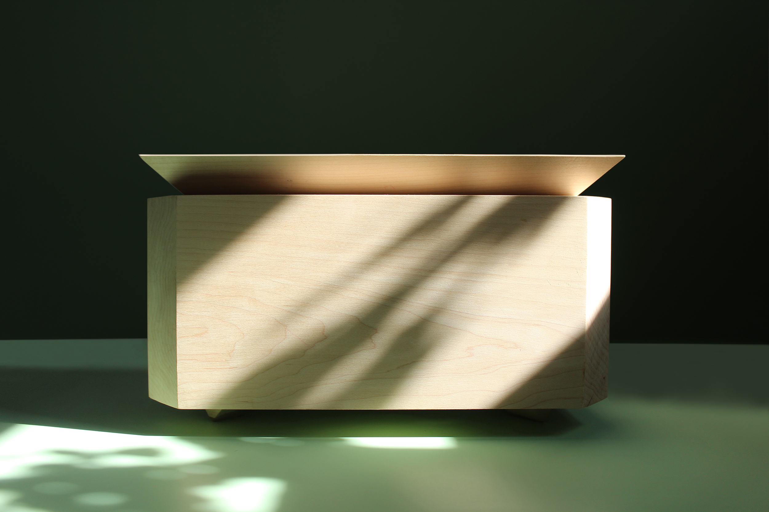 Closed jewelry box made out of white maple, with chamfered lid and corners