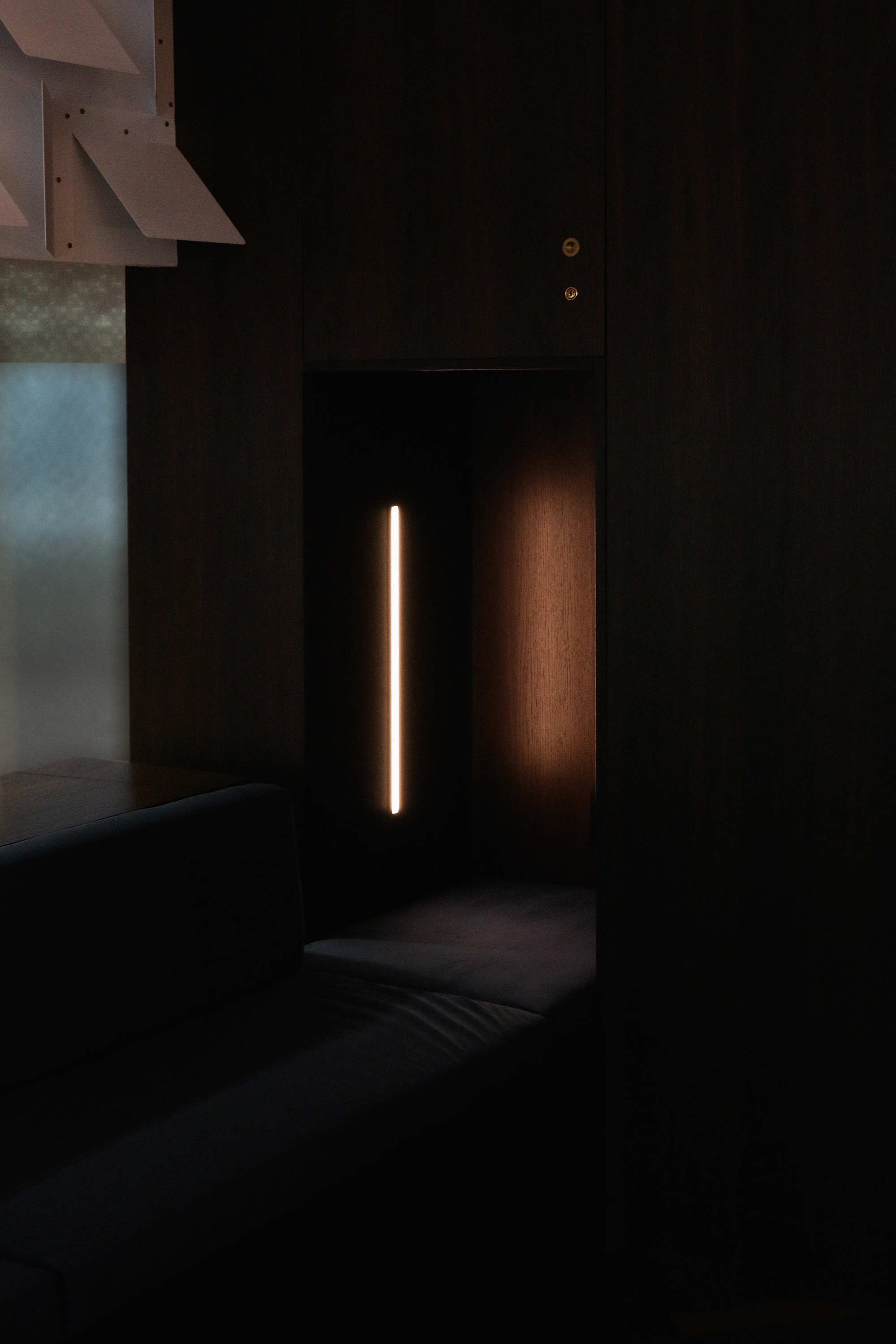 Listening nook with upholstered seat and linear LED light