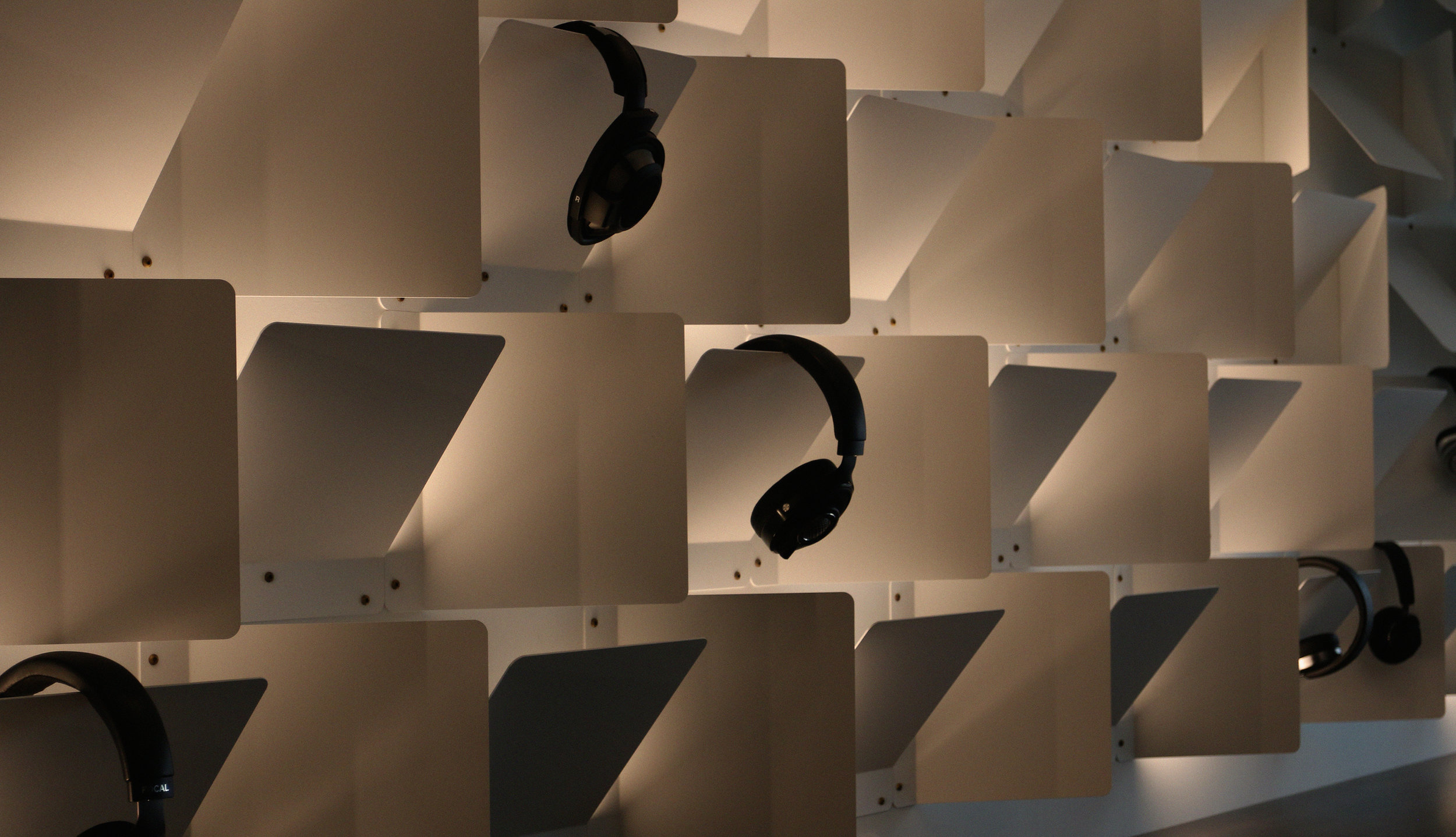 Metal panel modules being used as display infrastructure for headphones