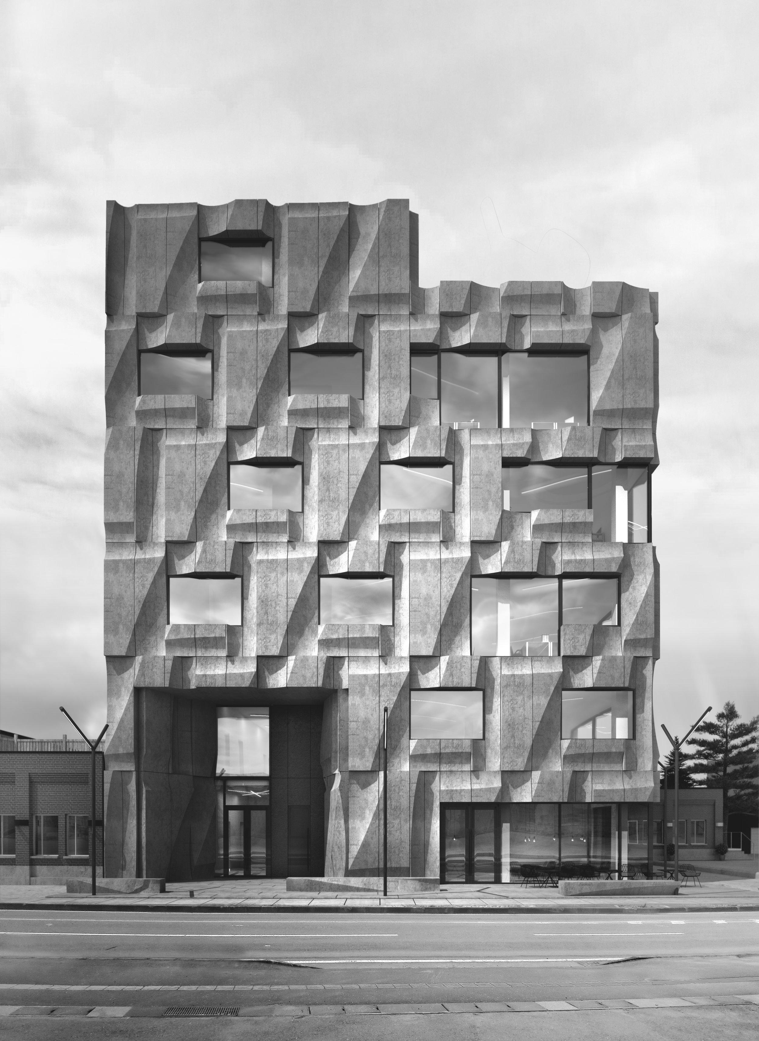 Elevational photo of front facade of mixed-use building with carved concrete panels and large sunken entry