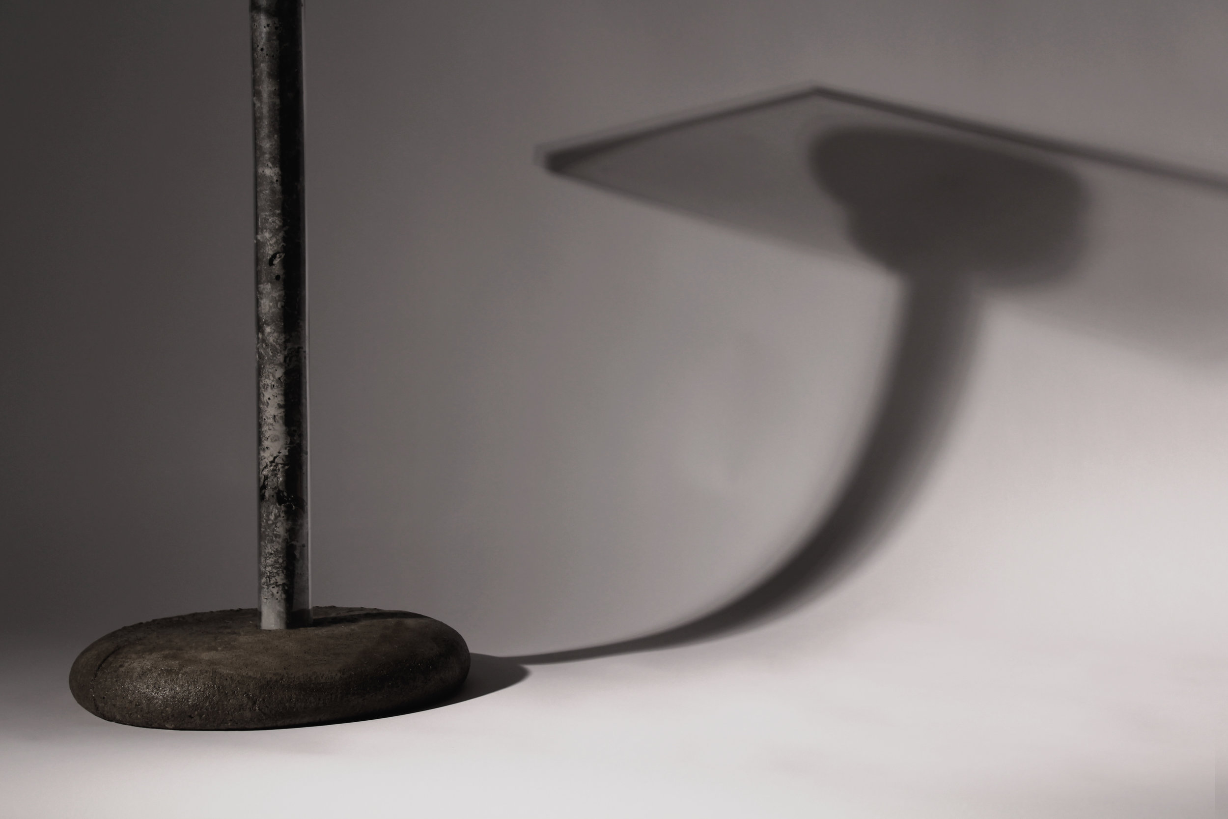 The weight of concrete is activated to create a base for the pedestal table