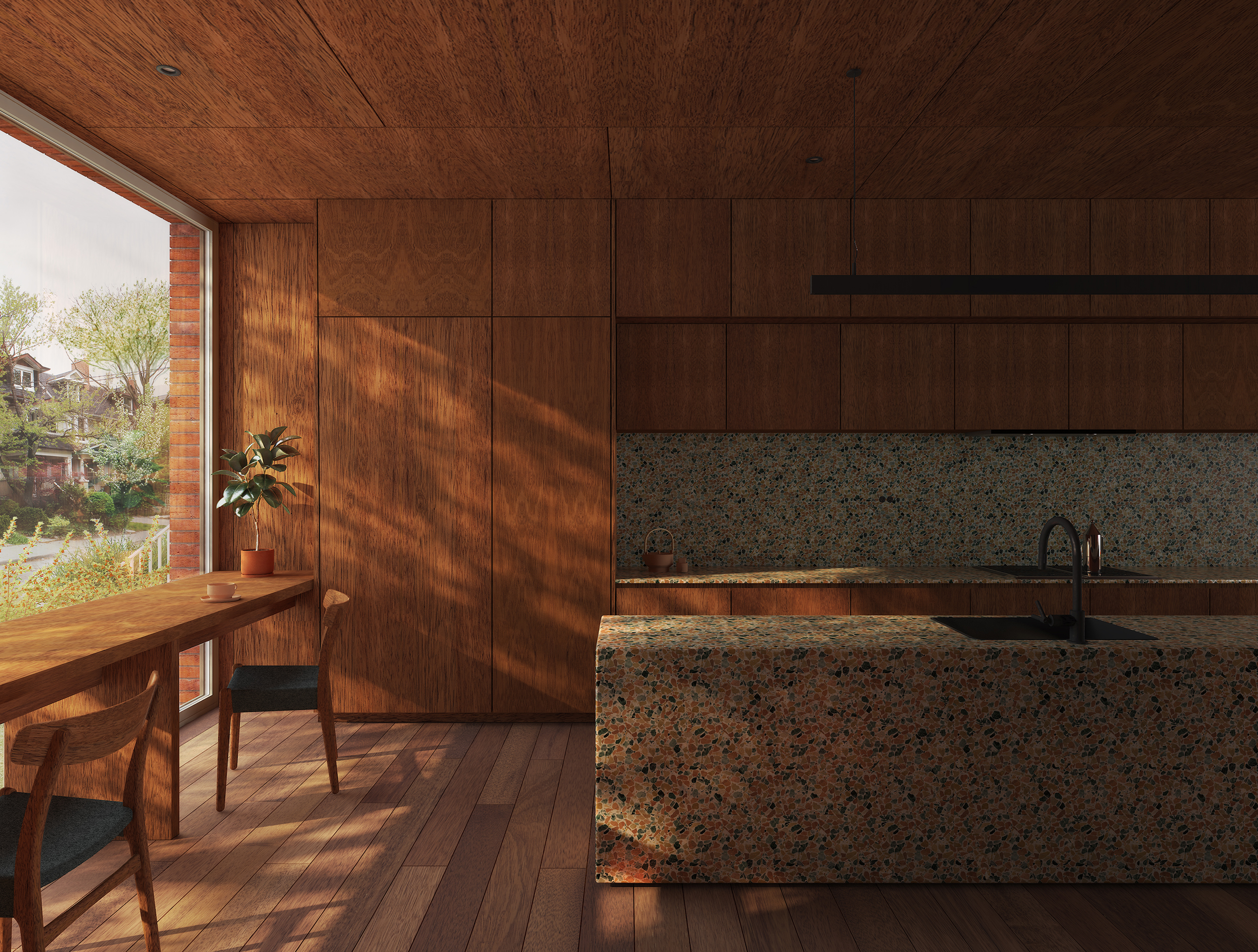 Interior view of kitchen with breakfast nook, wood millwork, and terrazzo counters