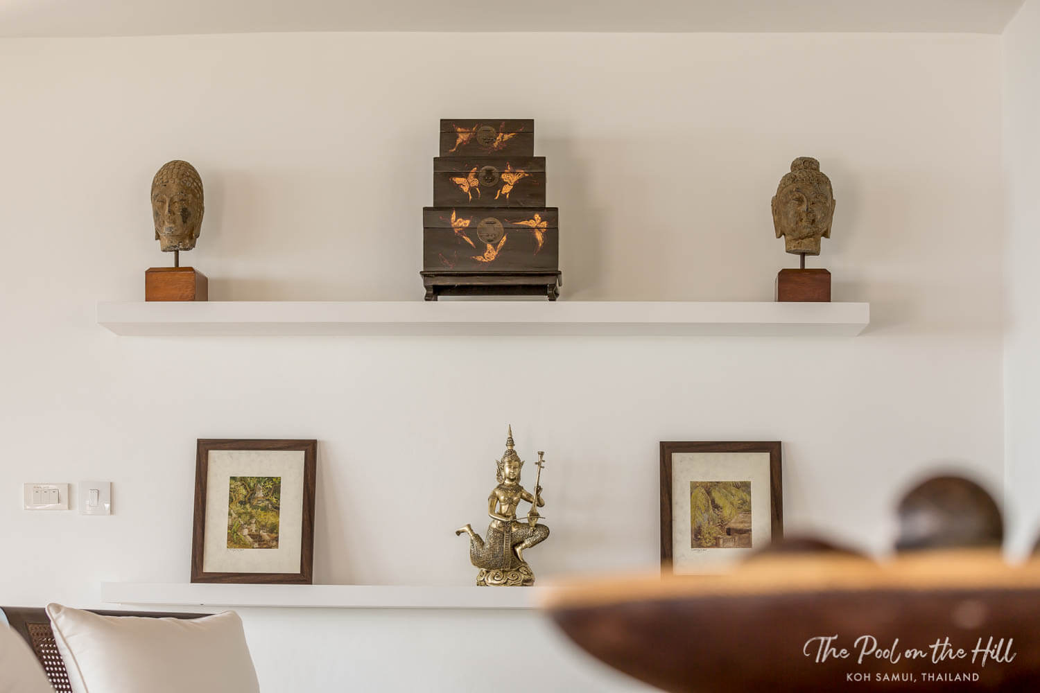 Thailand villa rental: Tour The Pool on the Hill's open-plan villa kitchen – Thai and Chinese antiques decorate the shelves in the open-plan kitchen and dining area.