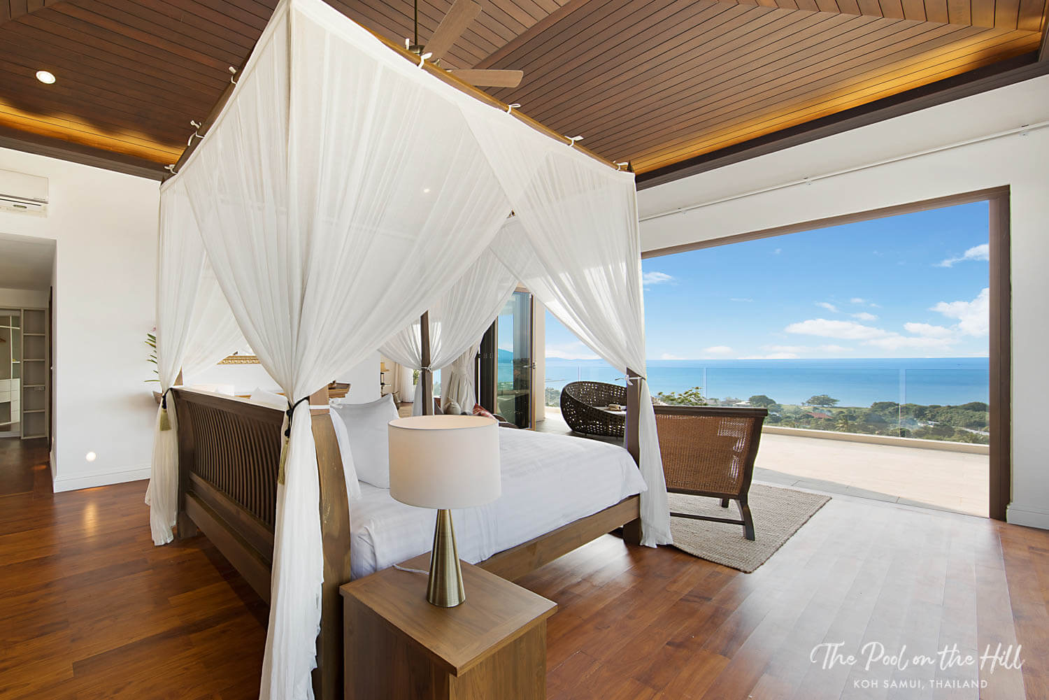 Five–Bedroom Private Villa in Koh Samui, Thailand: The large en suite master bathroom at The Pool on the Hill has double vanities, a large soaker bath tub and ocean views