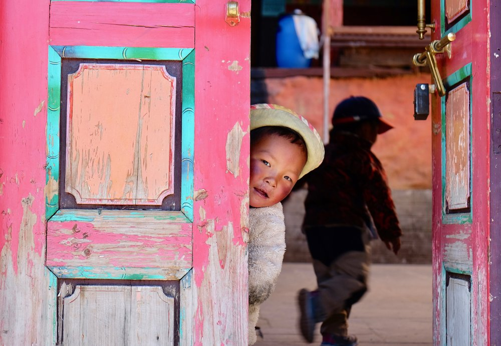 Sherpa children playing during the Nyungne Festival, Pangboche Monastery