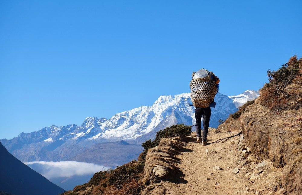 Porter summiting a ridge