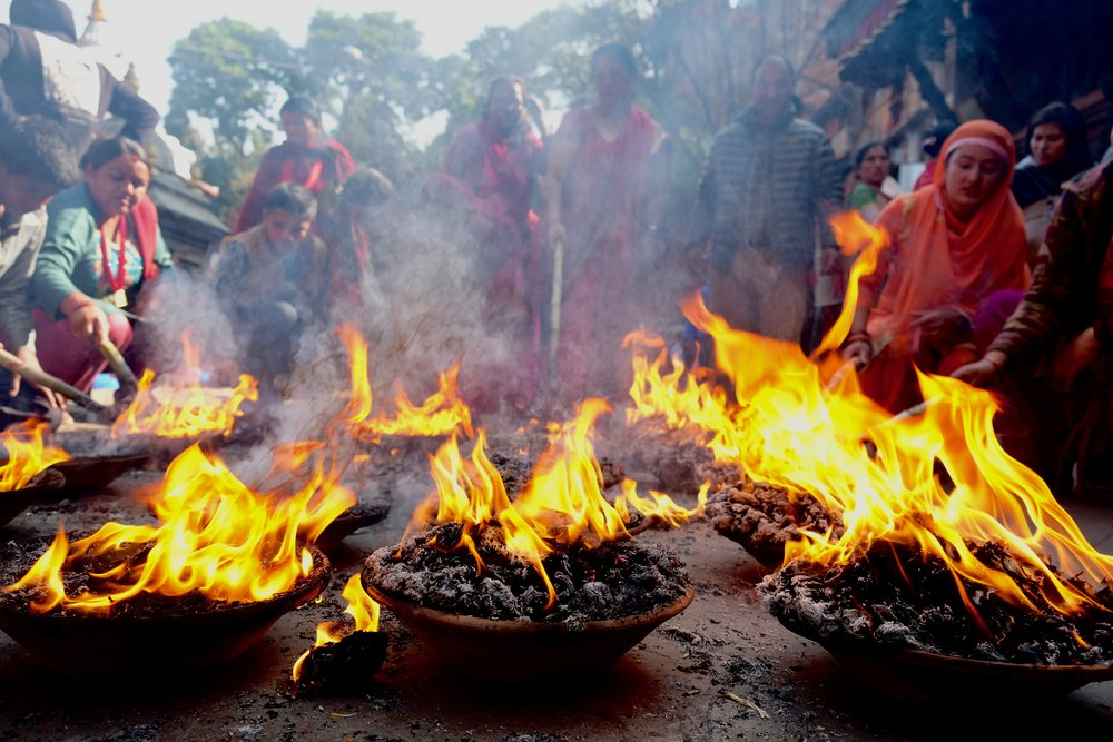 Burning offerings at a Hindu temple