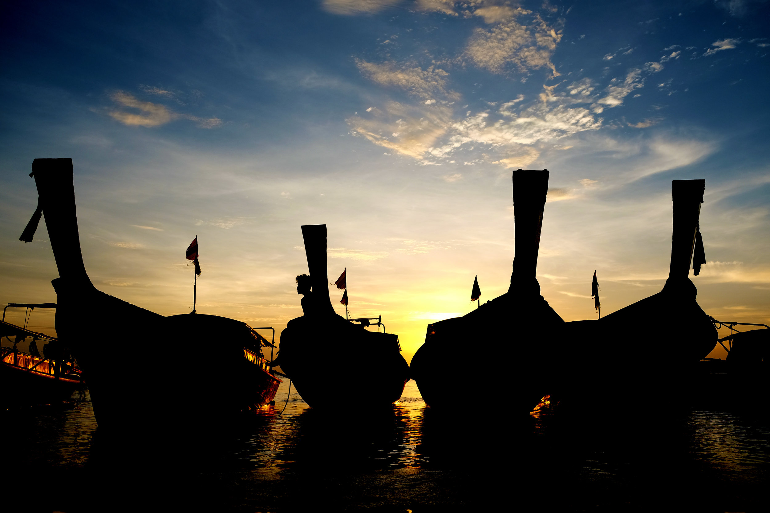 Long-tail boats at sunset