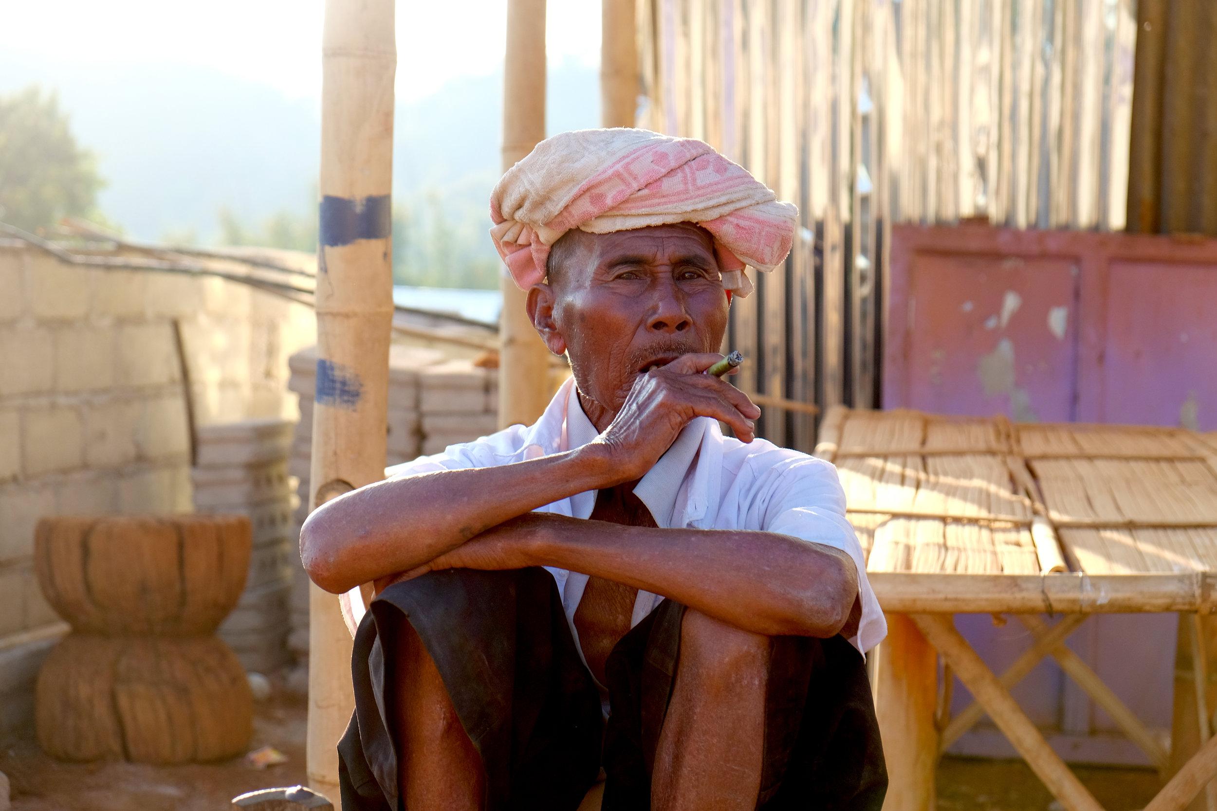 Tantu tribesman smoking a cheroot cigarette
