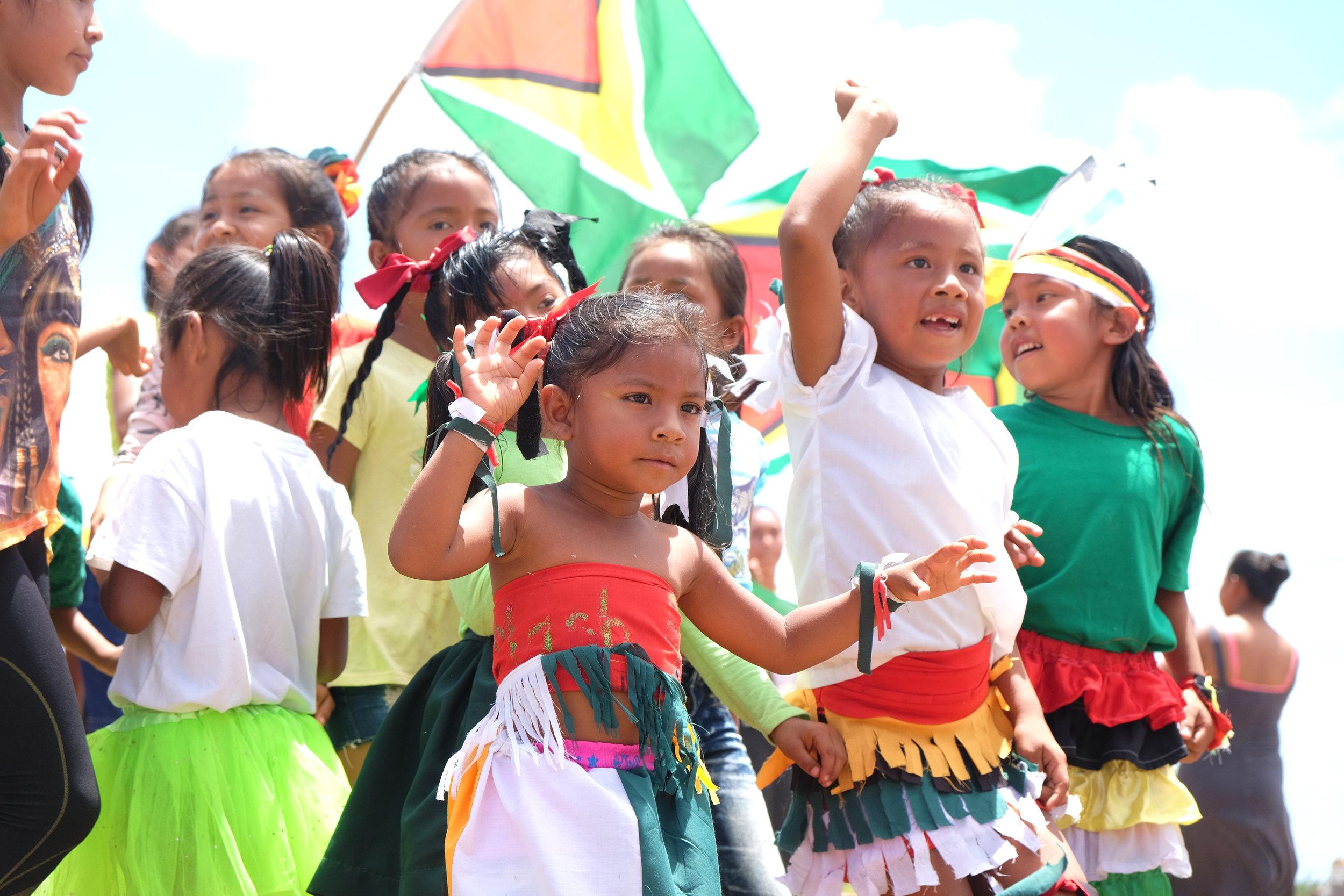 CHILDREN DANCING DURING MASHRAMANI (REPUBLIC DAY) FESTIVITIES IN THE RUPUNUNI SAVANNAH
