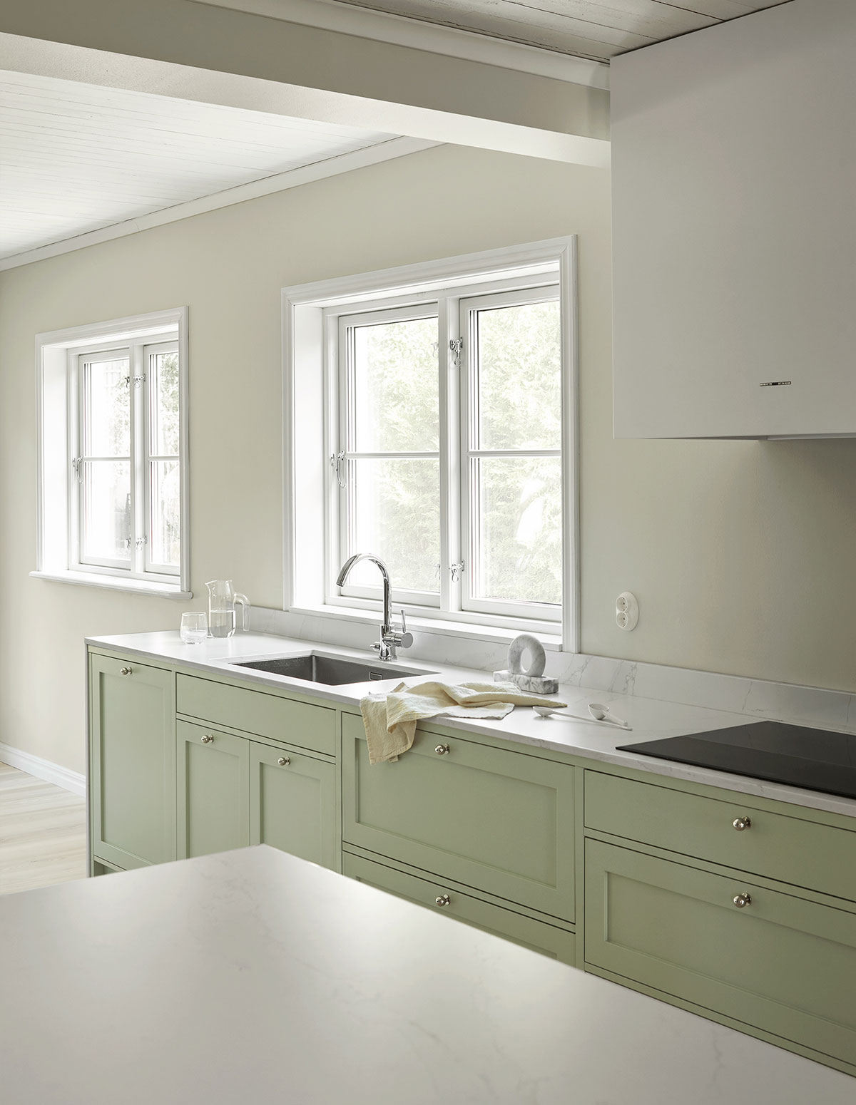 Shaker kitchen in light green in Scandinavian design with silestone countertop for founder of Stylein