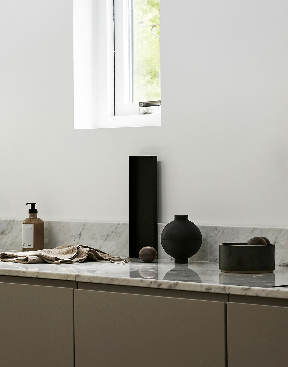Minimalist grey kitchen in modern Scandinavian design, vase by Kristina dam