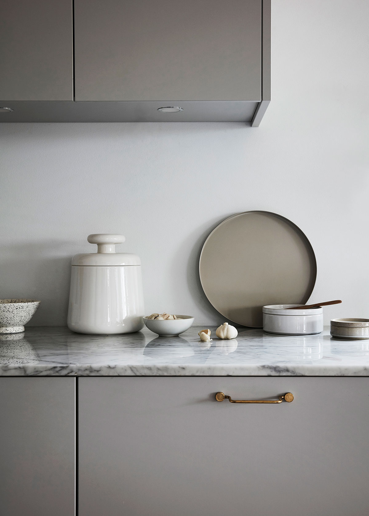 Minimalist grey kitchen in modern design with cooee plate