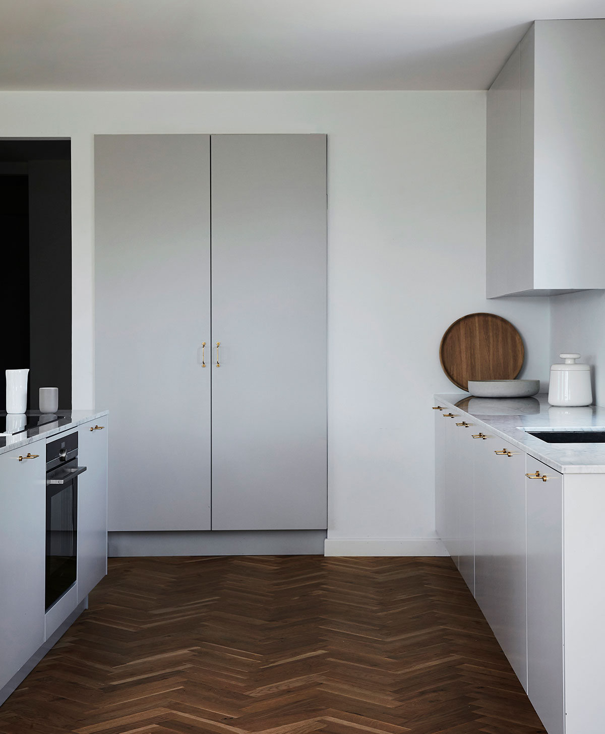 Minimalist grey kitchen in modern design with kitchen island