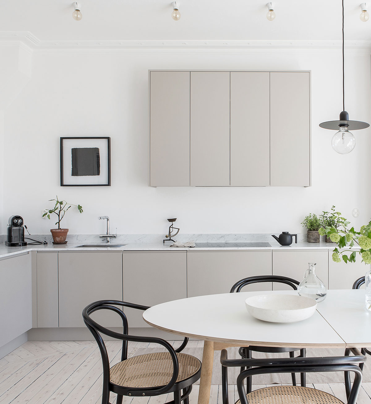 Minimalist grey kitchen inspiration with white marble countertop
