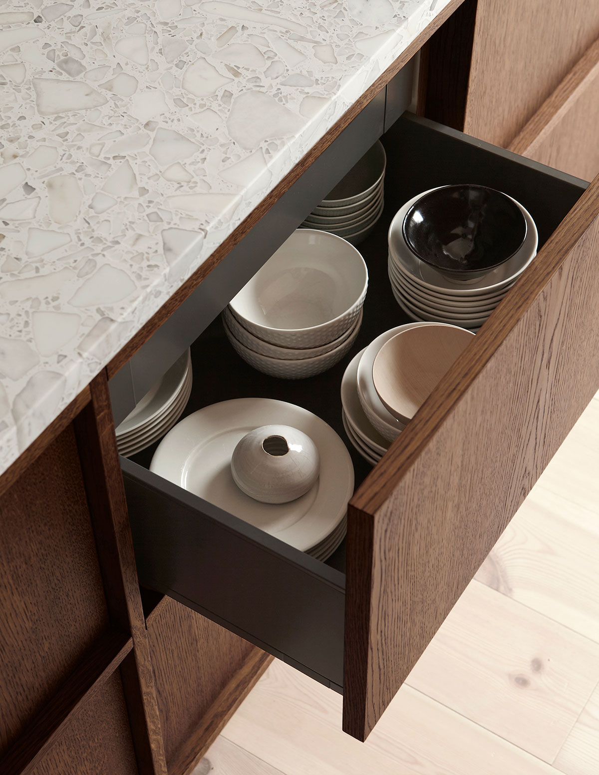 Wooden oak drawers in this in frame kitchen with terrazzo countertop