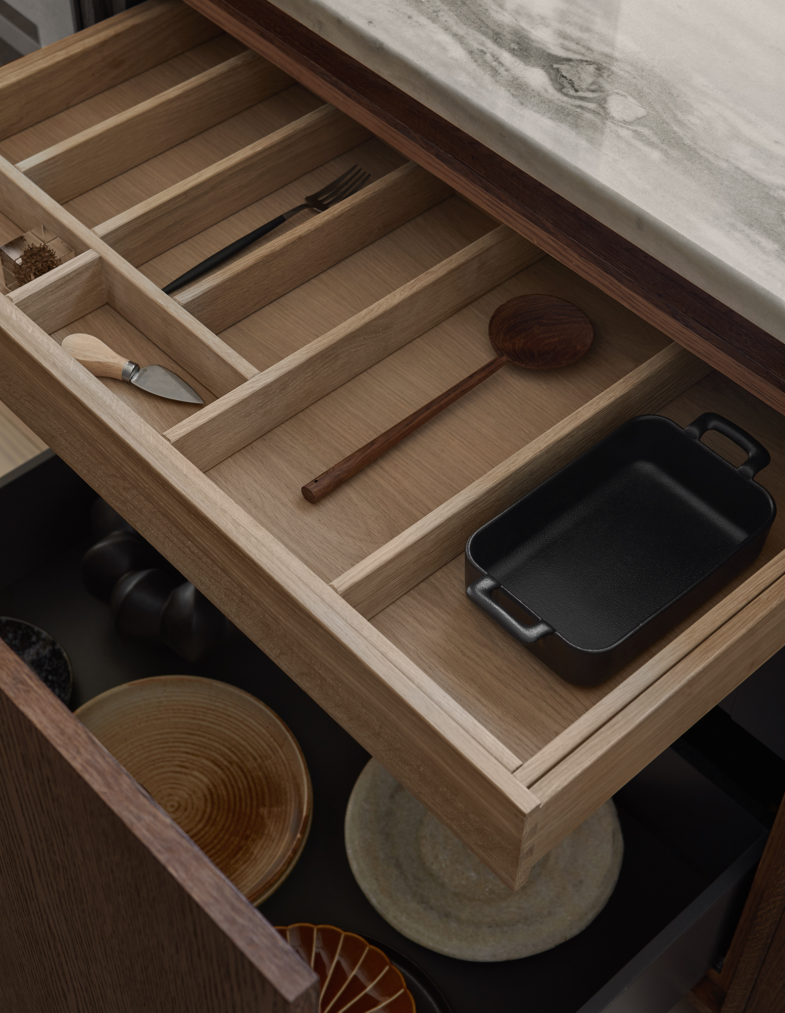 wooden kitchen drawers with marble countertop