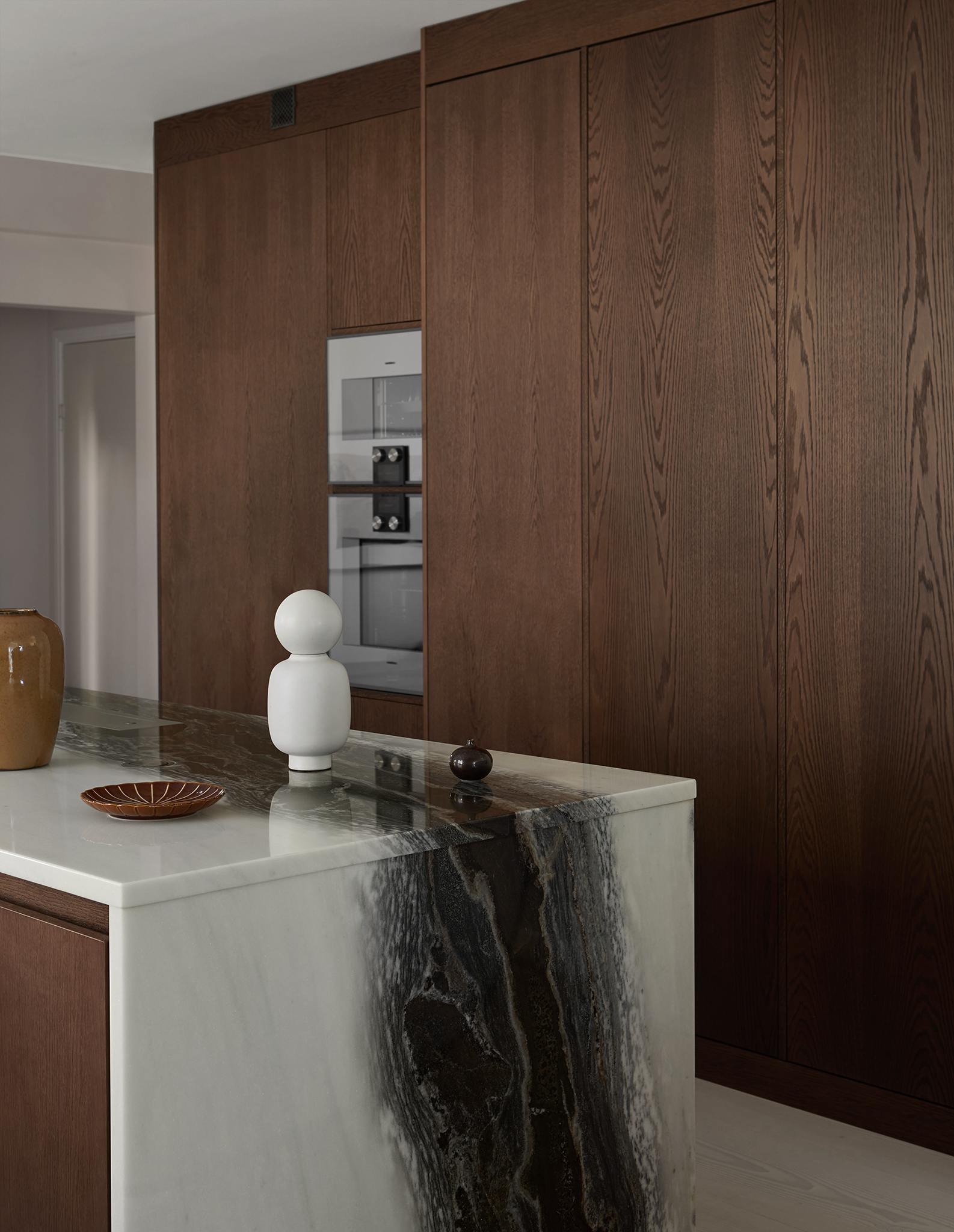 in frame wooden kitchen with marble countertop