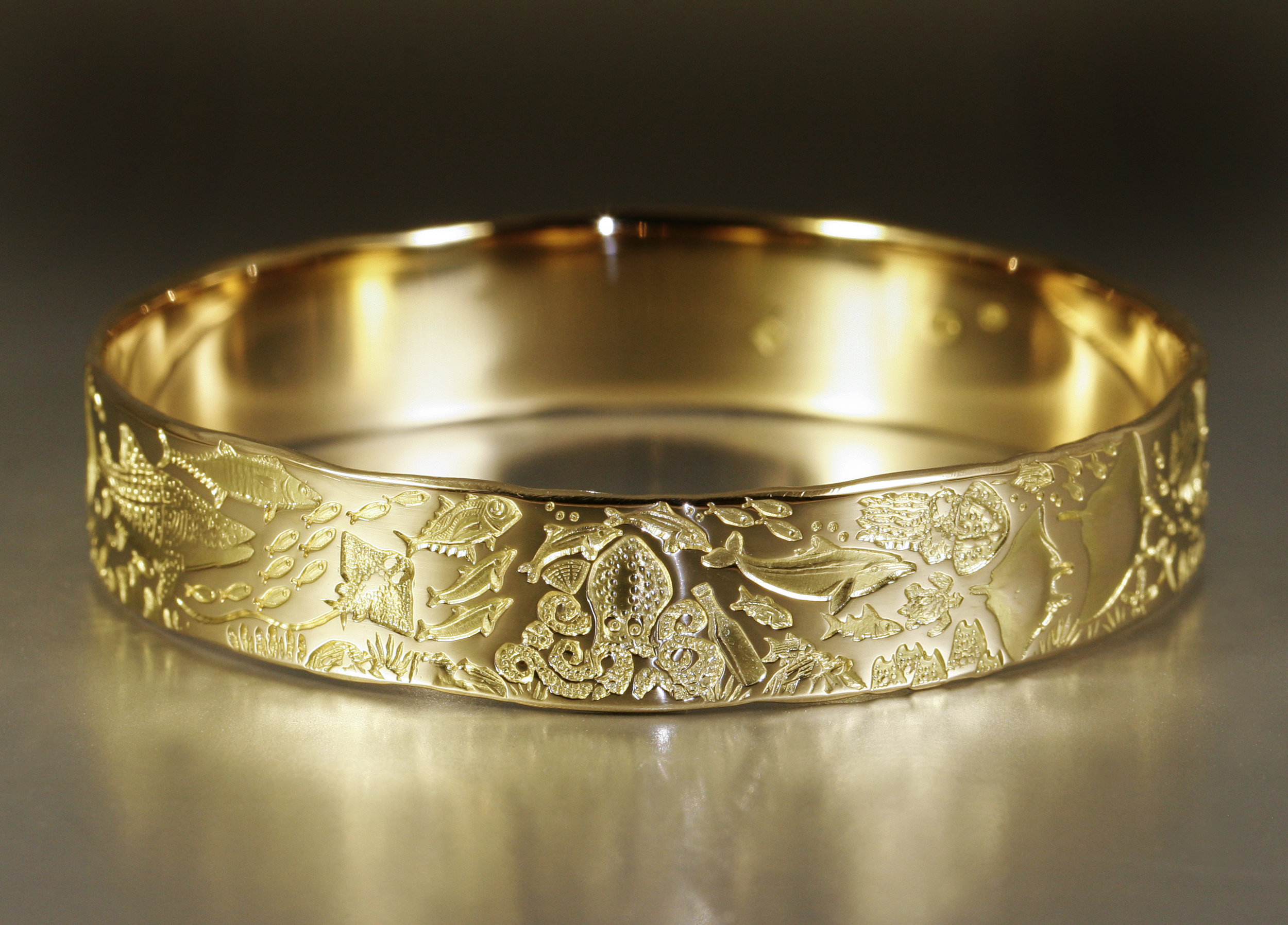J.Miller-Oceans-of-the-Universe-18ct-yellow-gold-bangle.jpg