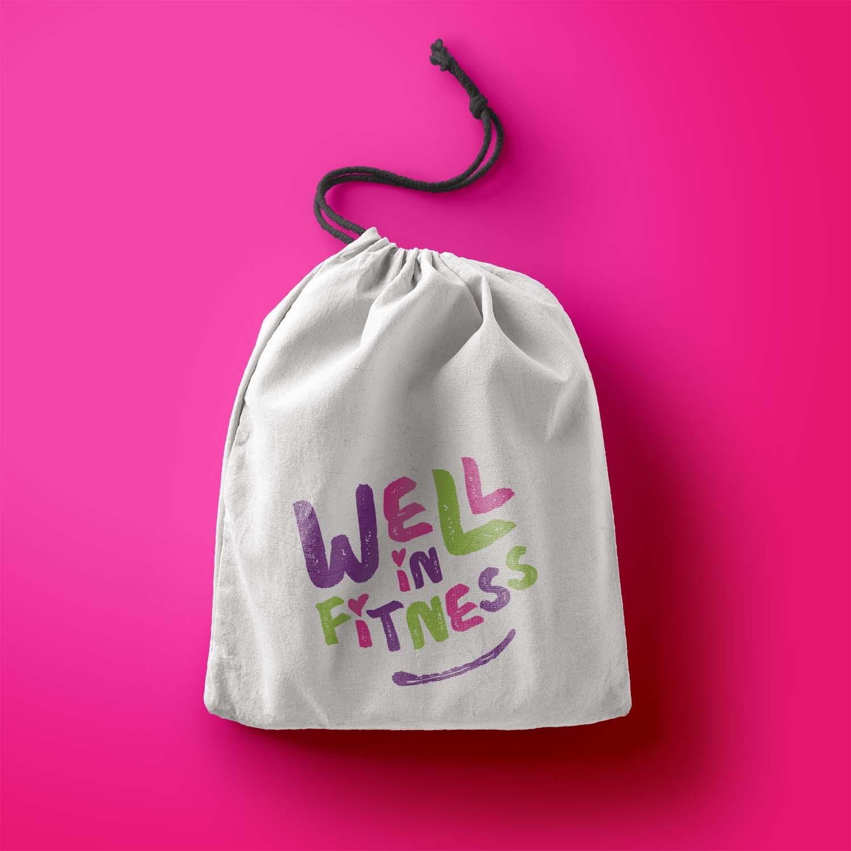 Portfolio project: Well In Fitness drawstring bag | Beehive Green Design Studio