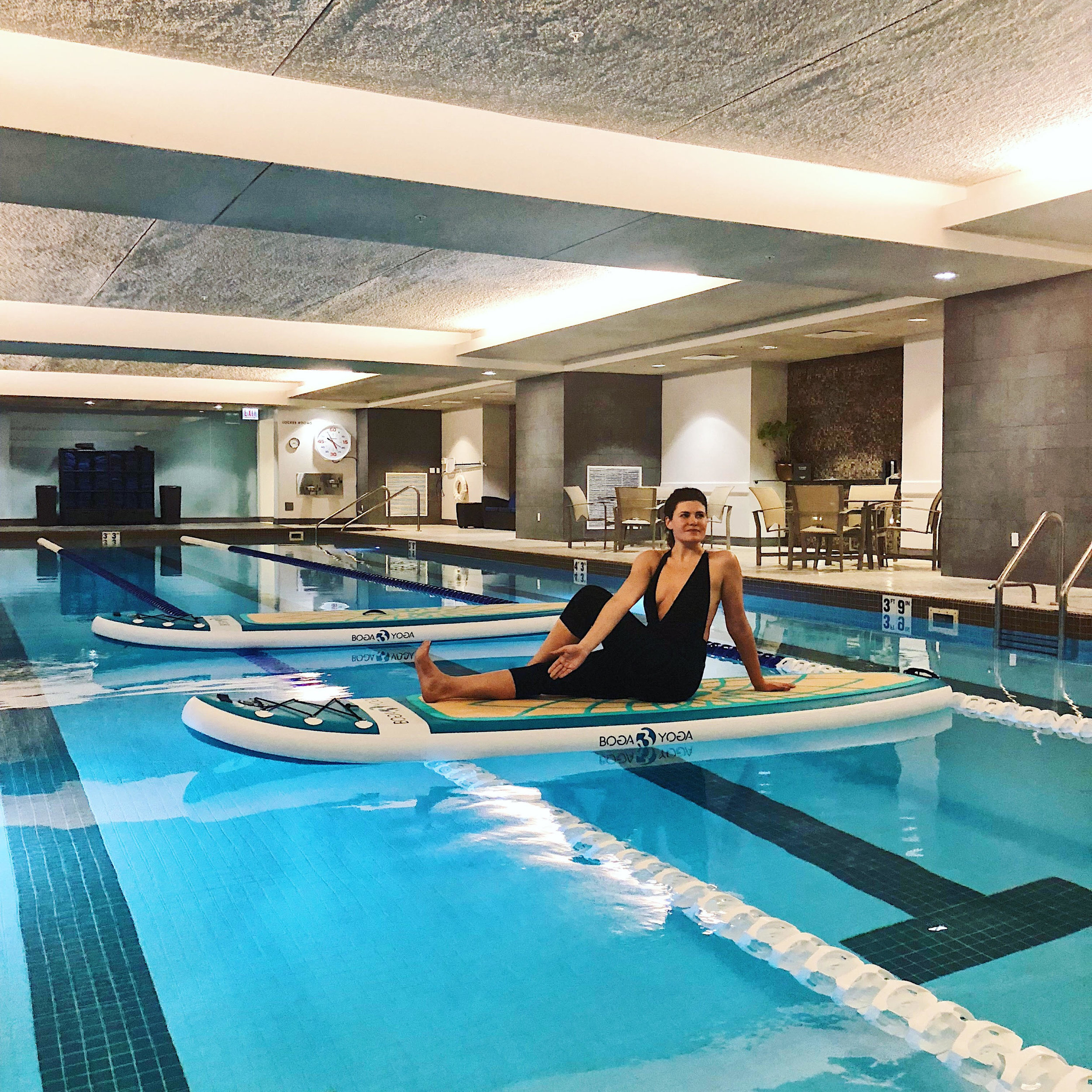 paddle board yoga  - tonight i tried something new, an indoor paddle board yoga class 🧘🏻‍♀️ thank you @koyoga_paddle for an amazing class 🙌🏻 catch her in the pool  at trumpchicago -xoxojackie