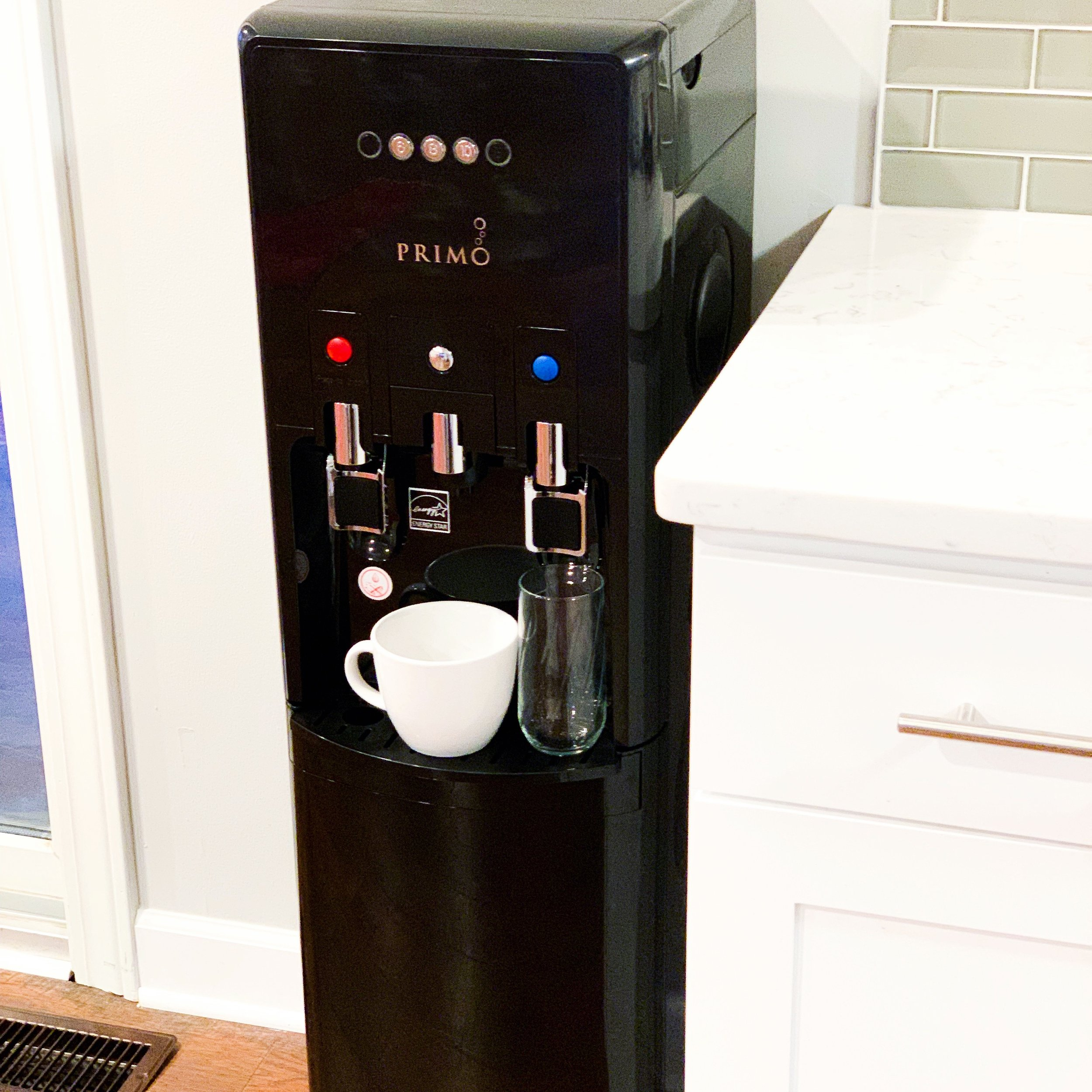 Primo Water Cooler - This sleek water cooler not only dispenses hot and cold water but also has a built in Keurig! SHOP HERE
