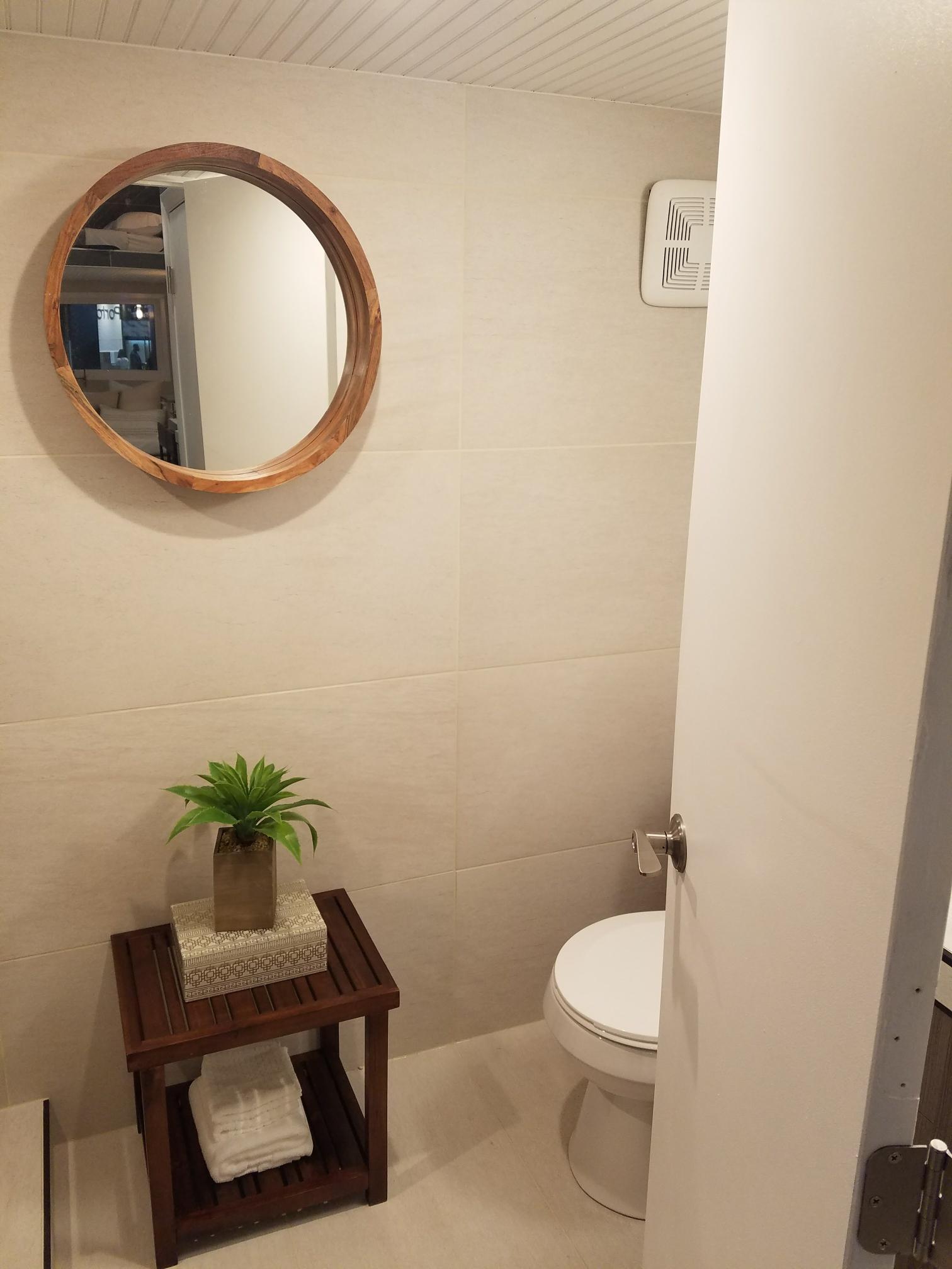 residential bath porcelin tiny home.jpeg