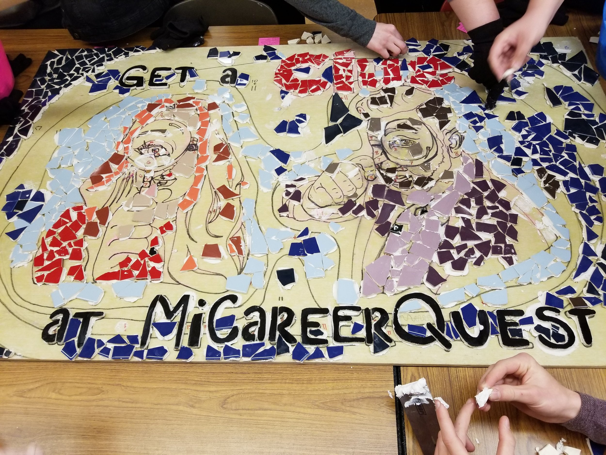 Students of Kent City High School working on the mosaic