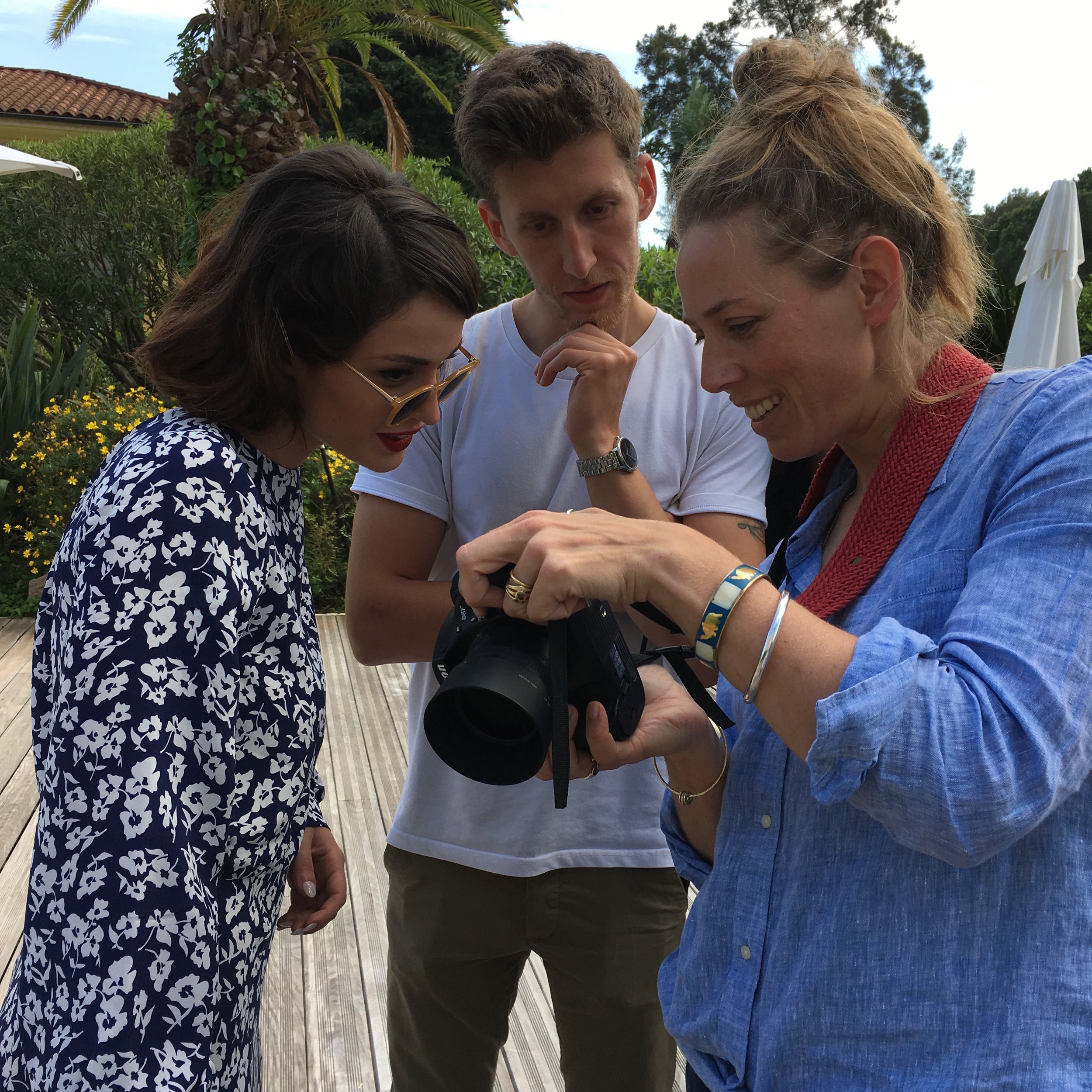 Margherita, Nico and Dorrie reviewing the photos