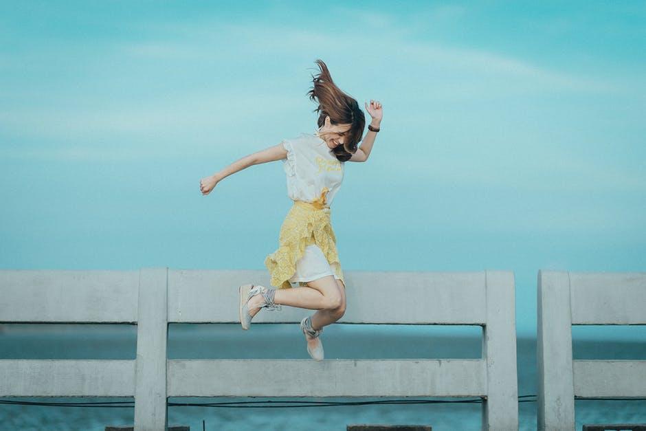 Woman Jumping Near Fence.jpeg