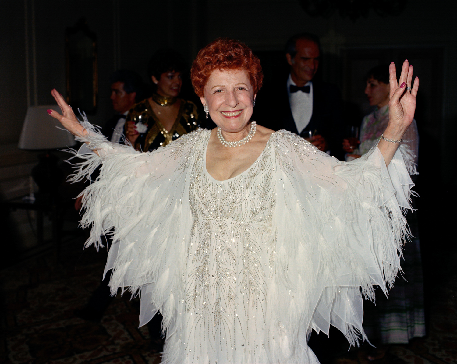 "Mother, 70, in her ostrich feather dress. This picture looked angry to me until Joan Coke exclaimed, ""My! What an elegant woman!"" Instantly, I missed her - the same picture no longer looked angry."
