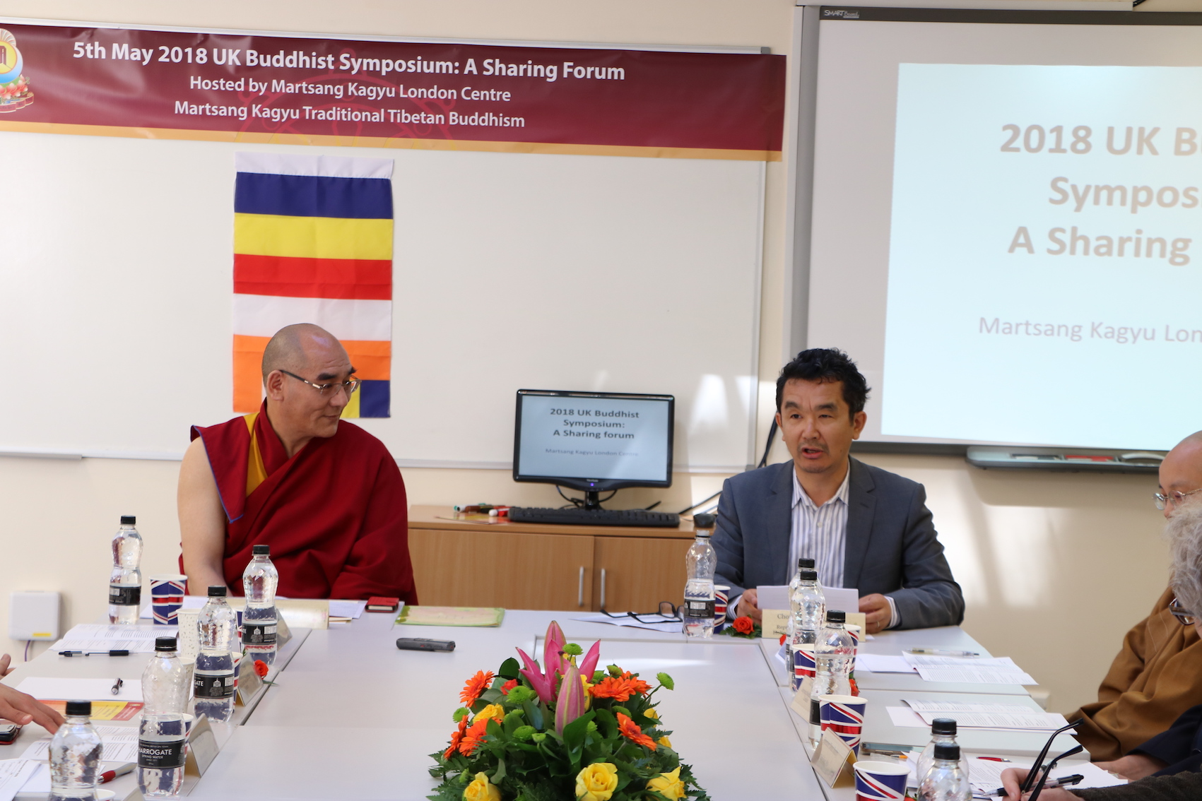 Representative of the Office of the Dalai Lama gives a talk at the beginning of the UK Buddhist Symposium hosted by Martsang Kagyu London Centre